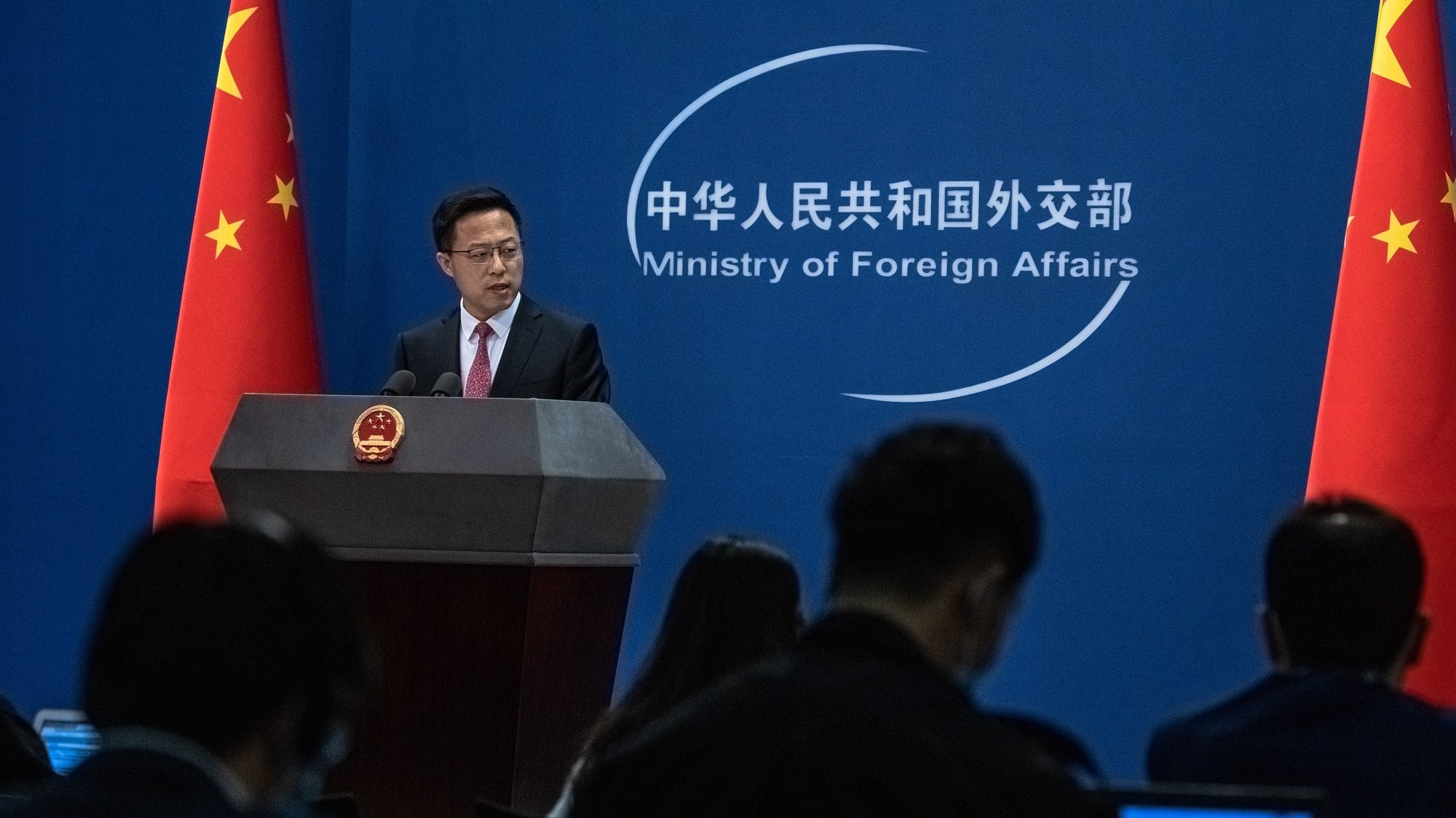 epa09083383 Chinese Foreign Ministry spokesman Zhao Lijian speaks during a daily media briefing in Beijing, China, 19 March 2021. Canadians Michael Spavor and Michael Kovrig, detained by Chinese authorities in 2018 and accused of espionage, will go on trial on 19 and 22 March 2021.  EPA/ROMAN PILIPEY