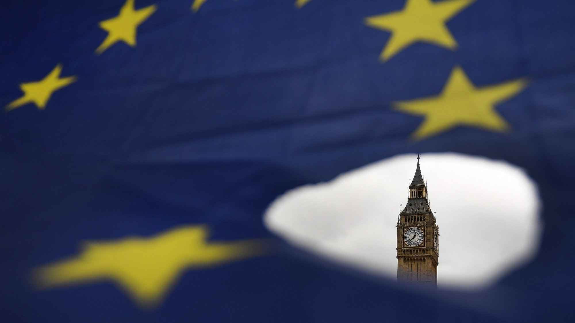 epa08429204 A European Union flag during a demonstration against Brexit outside the Houses of Parliament in London, Britain, 29 March 2017 (re-issued 18 May 2020). As prominent in both sky and sea, the color blue is often associated with open spaces, freedom, depth and wisdom. In psychology blue is viewed as a non-threatening color and it is believed to have positive and calming effects on body and mind. Often linked with intellect, confidence and reliability, it is known in corporate America as a power color.  EPA/ANDY RAIN ATTENTION: This Image is part of a PHOTO SET *** Local Caption *** 53417477