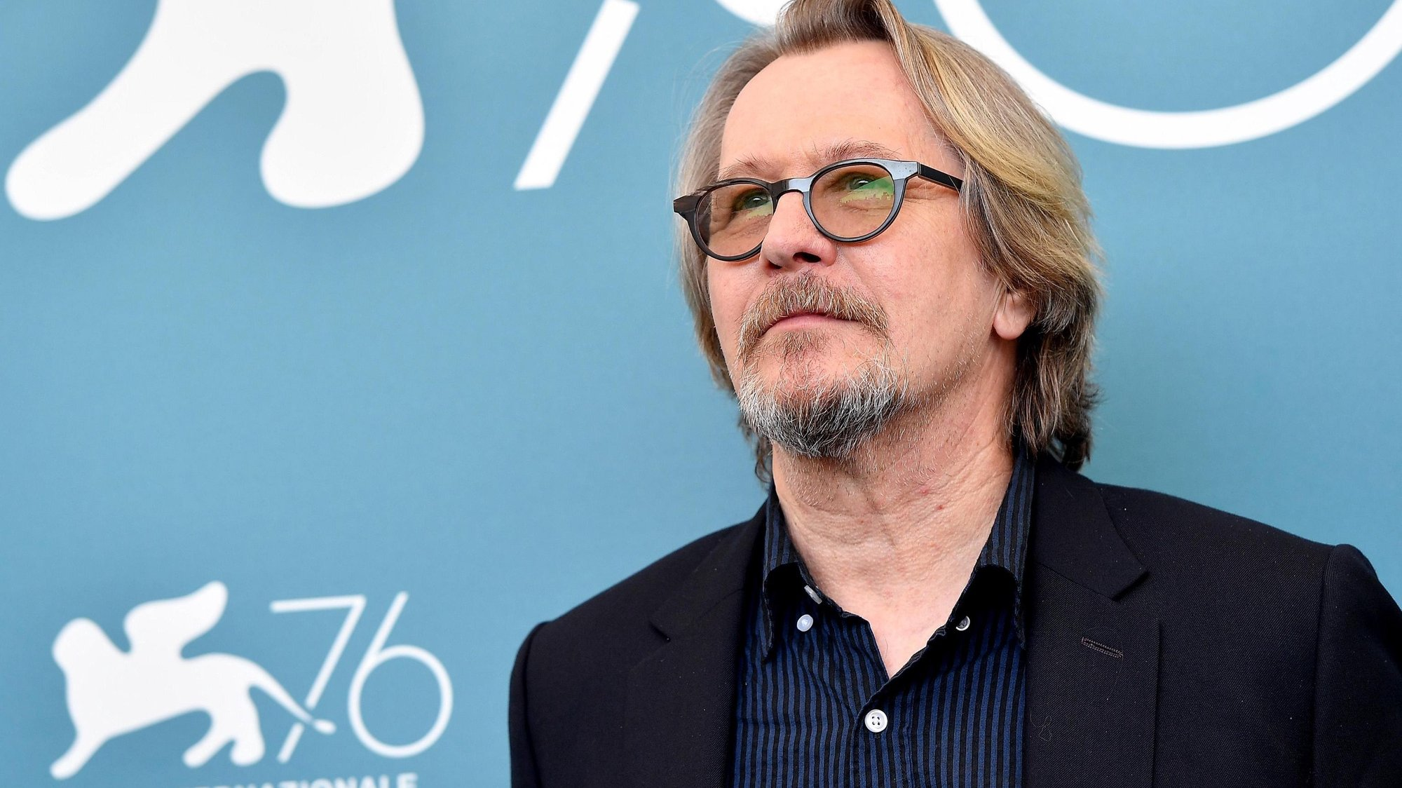epa07809954 British actor Gary Oldman poses at a photocall for 'The Laundromat' during the 76th annual Venice International Film Festival, in Venice, Italy, 01 September 2019. The movie is presented in official competition 'Venezia 76' at the festival running from 28 August to 07 September.  EPA/ETTORE FERRARI