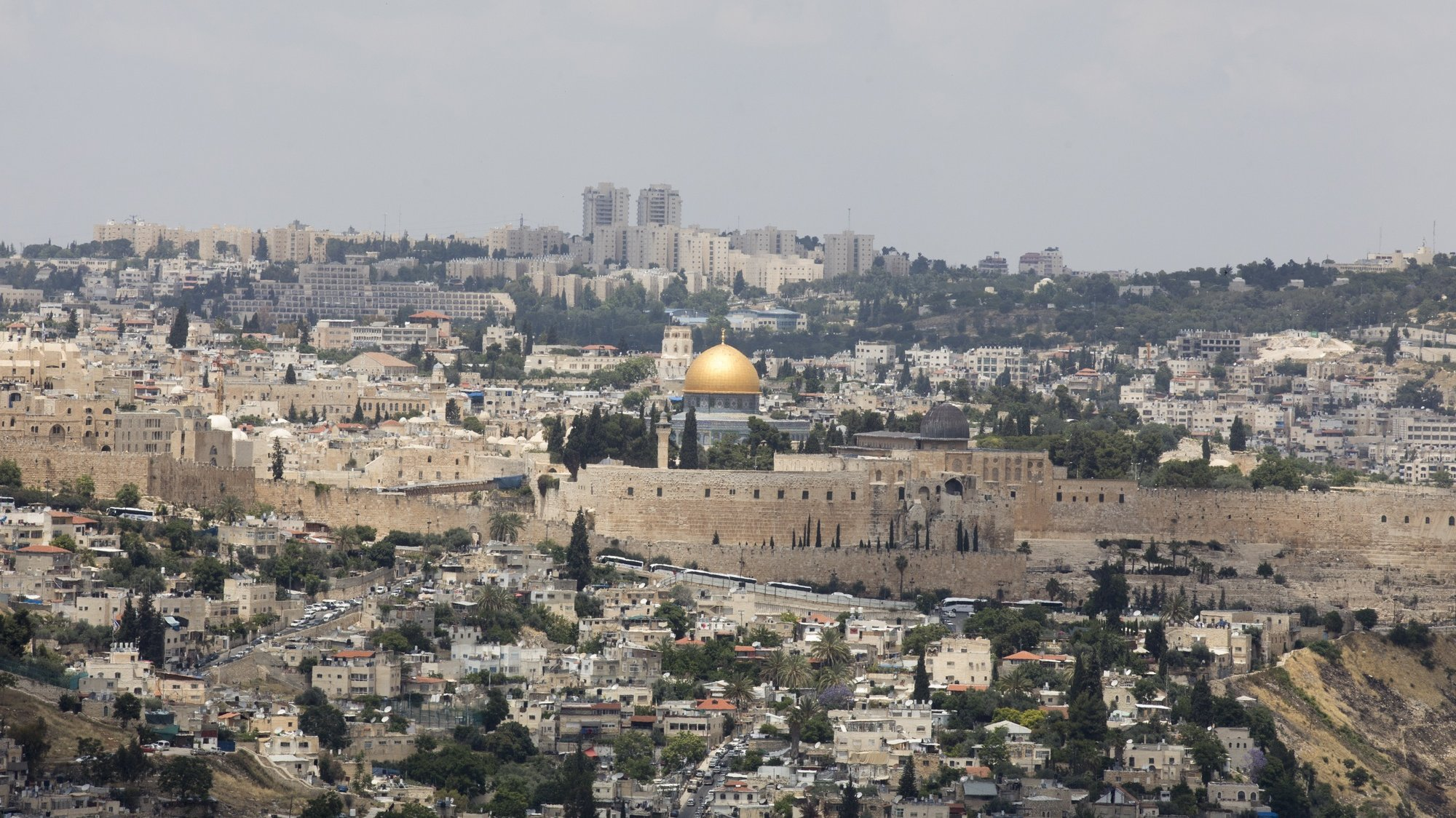 epa06735287 A general view of the Jerusalem old city as seen from Armon Hanatziv neighborhood next to the locations of the US embassy, ahead of events marking the embassy inauguration in Jerusalem in Jerusalem, 14 May 2018. US President Donald J. Trump's administration will officially transfer the ambassador's offices to the consulate building and temporarily use it as the new US Embassy in Jerusalem as of 14 May 2018. Trump in December last year recognized Jerusalem as Israel's capital and announced an embassy move from Tel Aviv, prompting protests in the occupied Palestinian territories and several Muslim-majority countries.  EPA/ATEF SAFADI