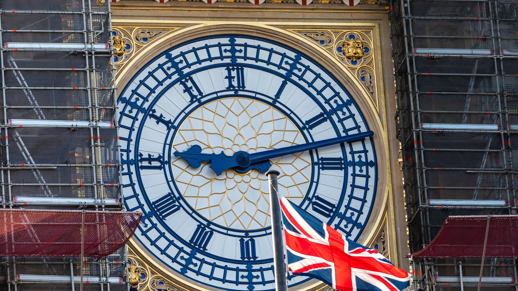 epa08863203 A Union Jack flag waves next to the clock face of Big Ben in Westminster, London, Britain, 05 December 2020. British and EU negotiators have paused Brexit talks because they say significant divergences remain and the conditions for a deal between the two sides have not been met.  EPA/VICKIE FLORES