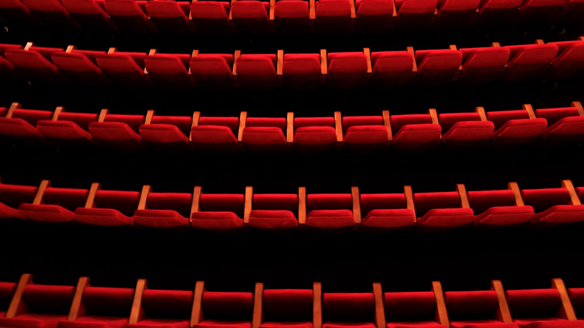 epa08829443 Empty seats at the Lichtburg Cinema in Essen, Germany, 19 November 2020. Due to an increasing number of cases of the pandemic COVID-19 disease, new nationwide restrictions have been announced to counter a surge in infections, such as closing cinemas for a month.  EPA/FRIEDEMANN VOGEL