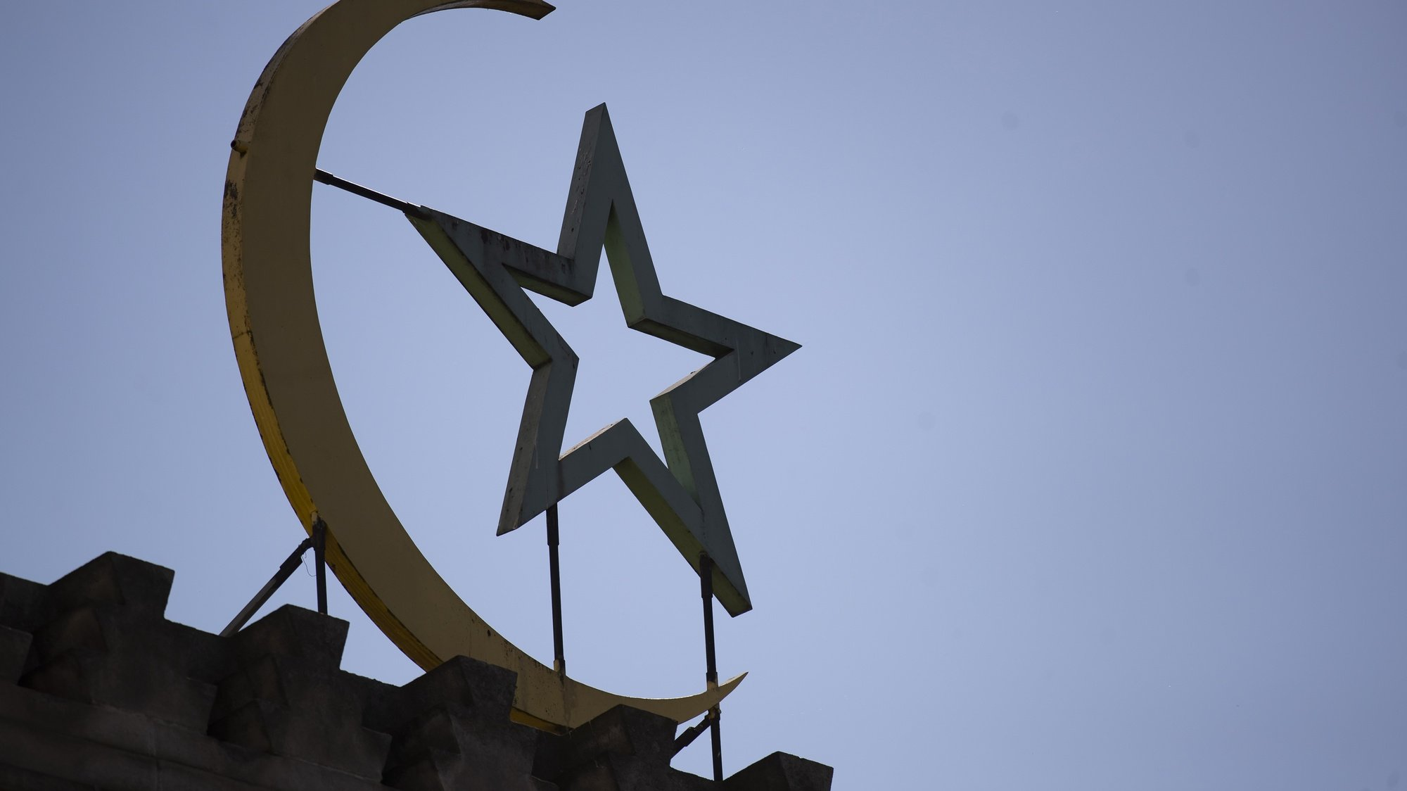 epa08377091 The star and crescent, symbol of Islam, is displayed on the entrance of Paris' Great Mosque a few days before the expected start of Ramadan, in Paris, France, 22 April 2020. Muslims around the world celebrate the holy month of Ramadan by praying during the night time and abstaining from eating, drinking, and sexual acts daily between sunrise and sunset. Ramadan is the ninth month in the Islamic calendar and it is believed that the Koran's first verse was revealed during its last 10 nights. Gatherings and group prayers will not be held at the mosque, as part of lockdown and confinement measures implemented in an attempt to stop the widespread of the SARS-CoV-2 coronavirus causing the Covid-19 disease.  EPA/IAN LANGSDON
