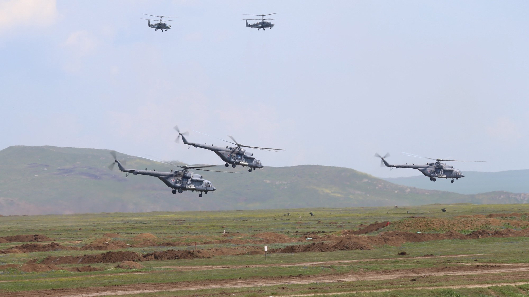 epa09152960 A handout photo made available by the press service of the Russian Defence Ministry shows Russian military helicopters during the main stage of the mixed exercise of the Russian Armed Forces at the at Opuk range  in Crimea, 22 April 2021. Units of the combined arms army, air force and air defen–e formations, warships and ships, military units of the coastal forces of the Black Sea Fleet, part of the forces of the Caspian Flotilla and airborne units take part in the military exercises at the Opuk training ground.  EPA/VADIM SAVITSKY / RUSSIAN DEFENCE MINISTRY / HANDOUT MANDATORY CREDIT / HANDOUT EDITORIAL USE ONLY/NO SALES
