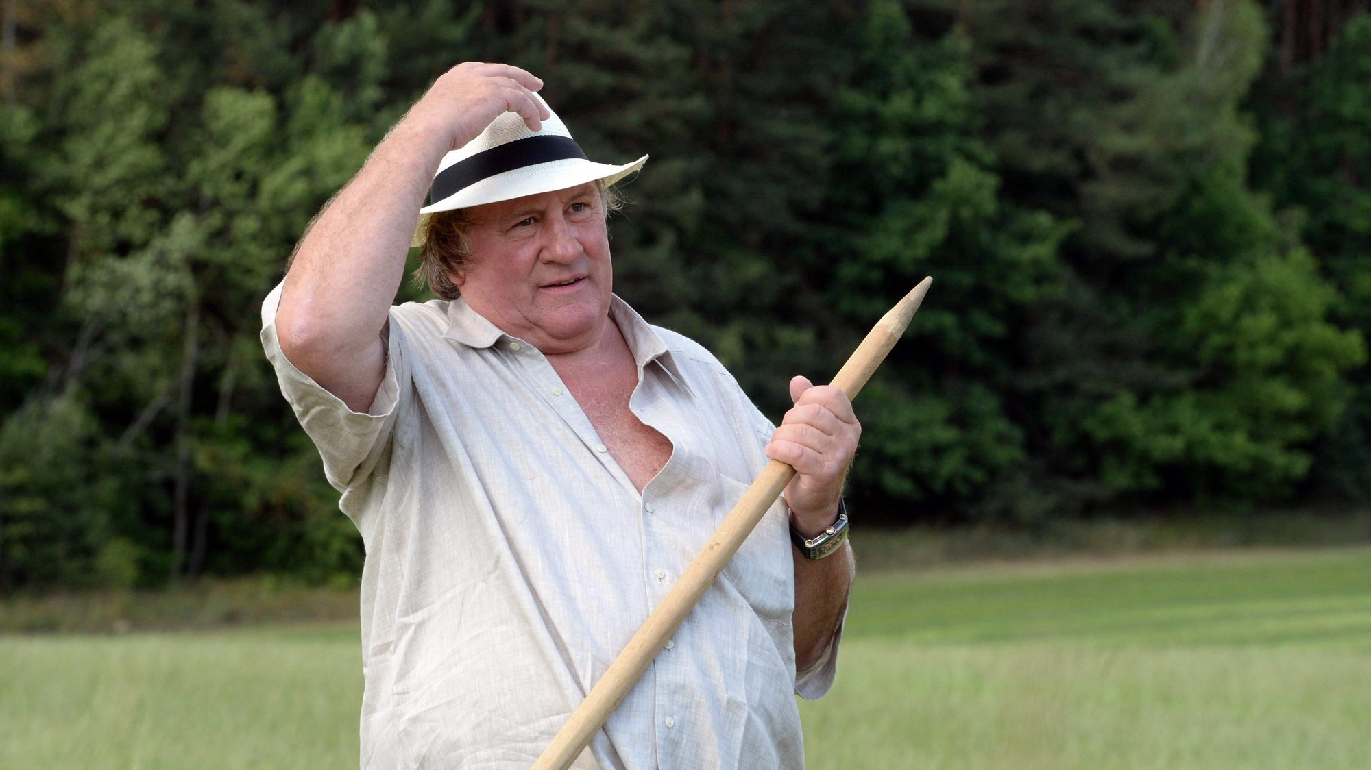 epa09032153 (FILE) - French actor Gerard Depardieu participates in hand-scything on the territory of the Ozerny official presidential residence outside Minsk, Belarus, 22 July 2015  (reissued 23 February 2021). French media citing judicial sources report on 23 February 2021 that Depardieu has been charged with rape. The French actor had already been accused of rape and sexual assault in 2018.  EPA/ANDREI STASEVICH POOL *** Local Caption *** 54851032