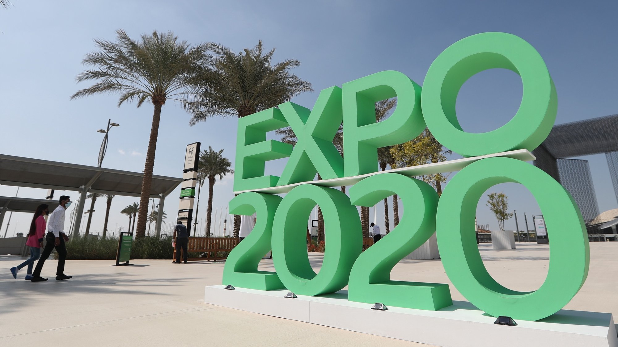 epa08986653 People walk at the building of Terra the Sustainability Pavilion at Expo 2020 Dubai site, Dubai, United Arab Emirates, 27 January 2021 (issued 04 February 2021). Terra, the Sustainability Pavilion, has been opened to the public, ahead of the Expo 2020 official opening scheduled for 01 October after it was postponed from October 2020 due to the COVID 19 pandemic.  EPA/ALI HAIDER