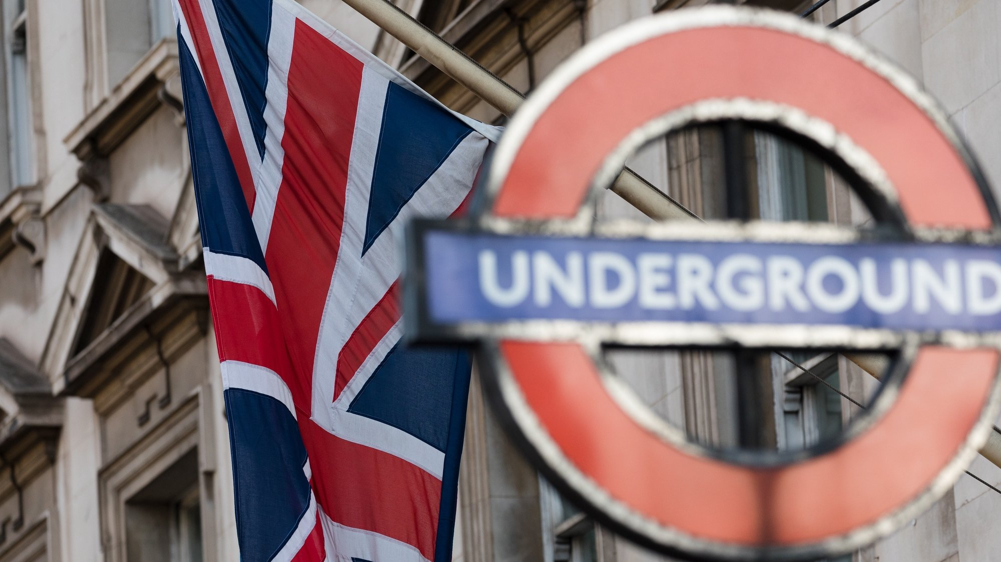 epa08863202 A Union Jack flag waves next to an underground tube sign in Westminster, London, Britain, 05 December 2020. British and EU negotiators have paused Brexit talks because they say significant divergences remain and the conditions for a deal between the two sides have not been met.  EPA/VICKIE FLORES