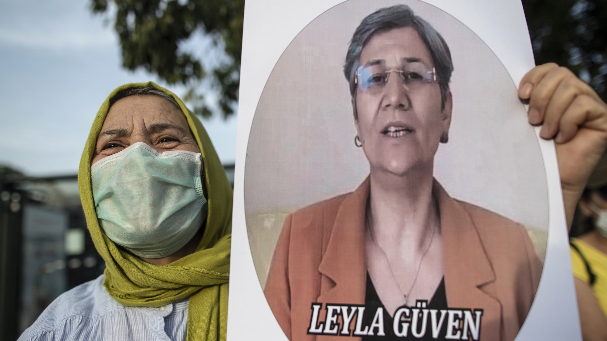 epa08469642 A woman holds picture of Leyla Guven during a protest against the arrest of pro-Kurdish People's Democtaric Party HDP parliamentarians Leyla Guven and Musa Farisogullari, in Istanbul, Turkey, 06 June 2020. The opposition politicians were stripped of their parliamentary seats and taken into custody.  EPA/ERDEM SAHIN