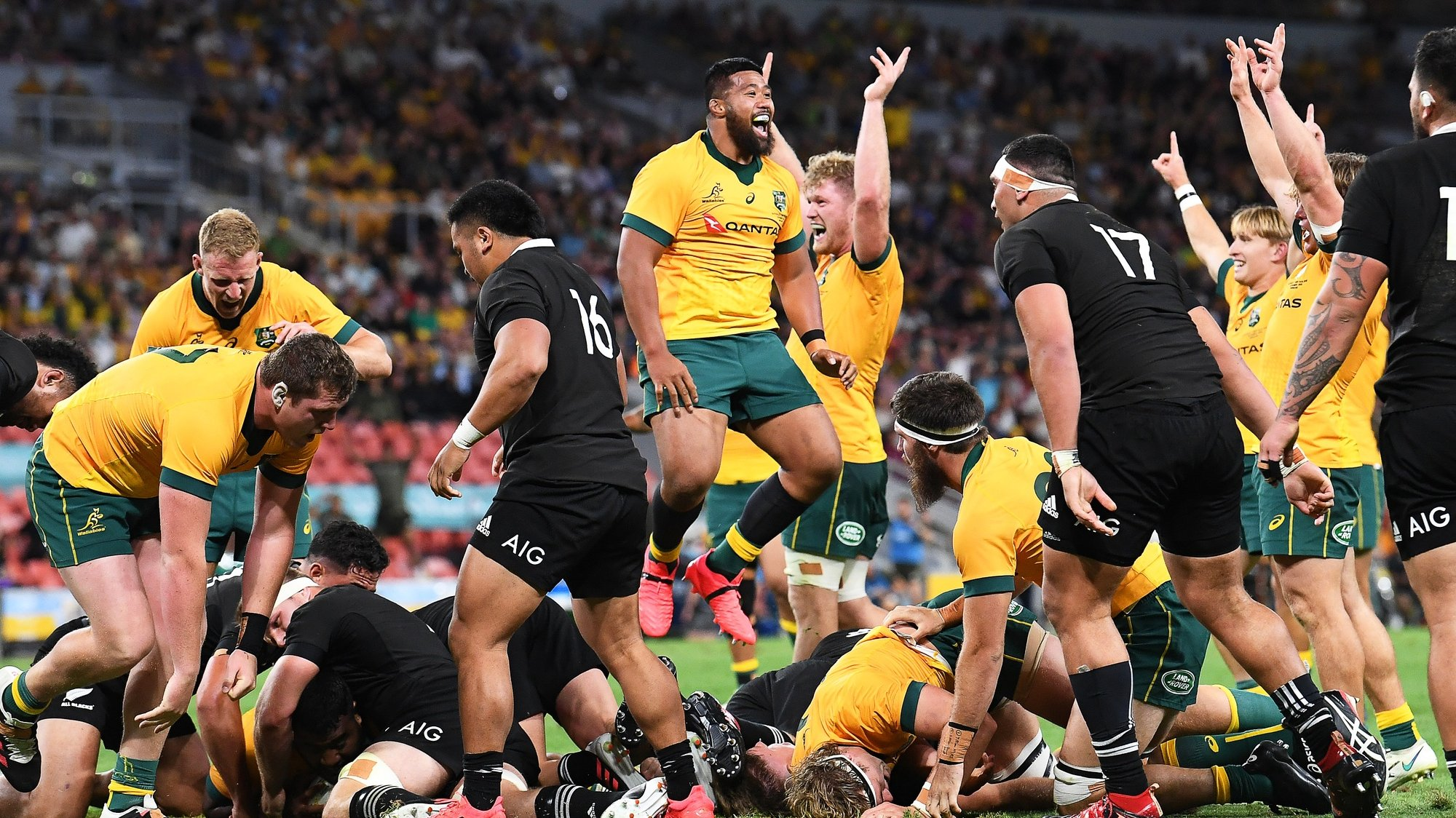 epa08804288 Taniela Tupou (C) of the Wallabies celebrates after scoring a try during the Tri Nations rugby union match between the Australian Wallabies and the New Zealand All Blacks in Brisbane, Australia, 07 November 2020.  EPA/DAVE HUNT AUSTRALIA AND NEW ZEALAND OUT