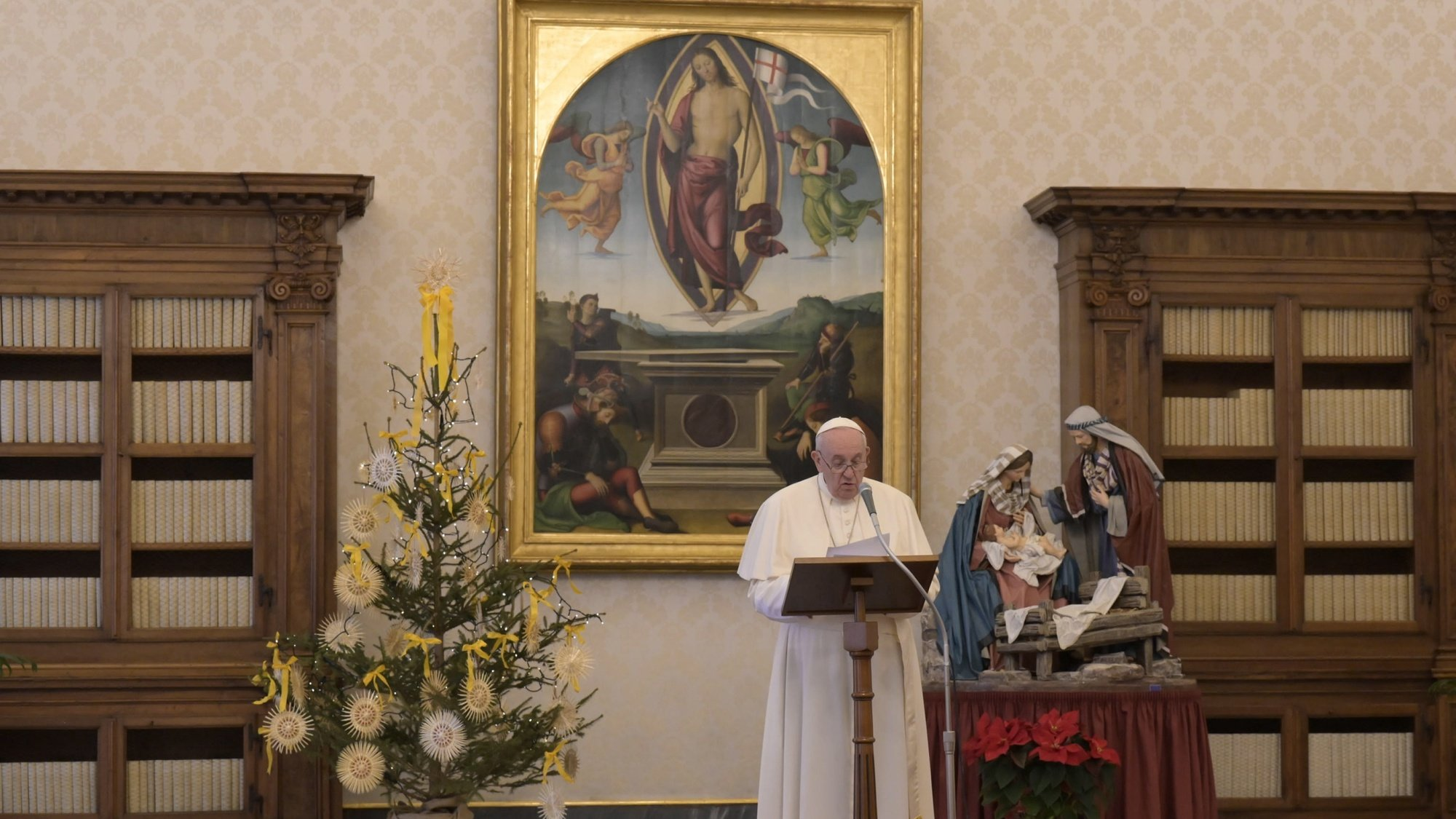 epa08914157 A handout picture provided by the Vatican Media shows Pope Francis delivering a live-streamed weekly Angelus prayer from the Library of the Apostolic Palace at the Vatican, 01 January 2021.  EPA/VATICAN MEDIA HANDOUT  HANDOUT EDITORIAL USE ONLY/NO SALES