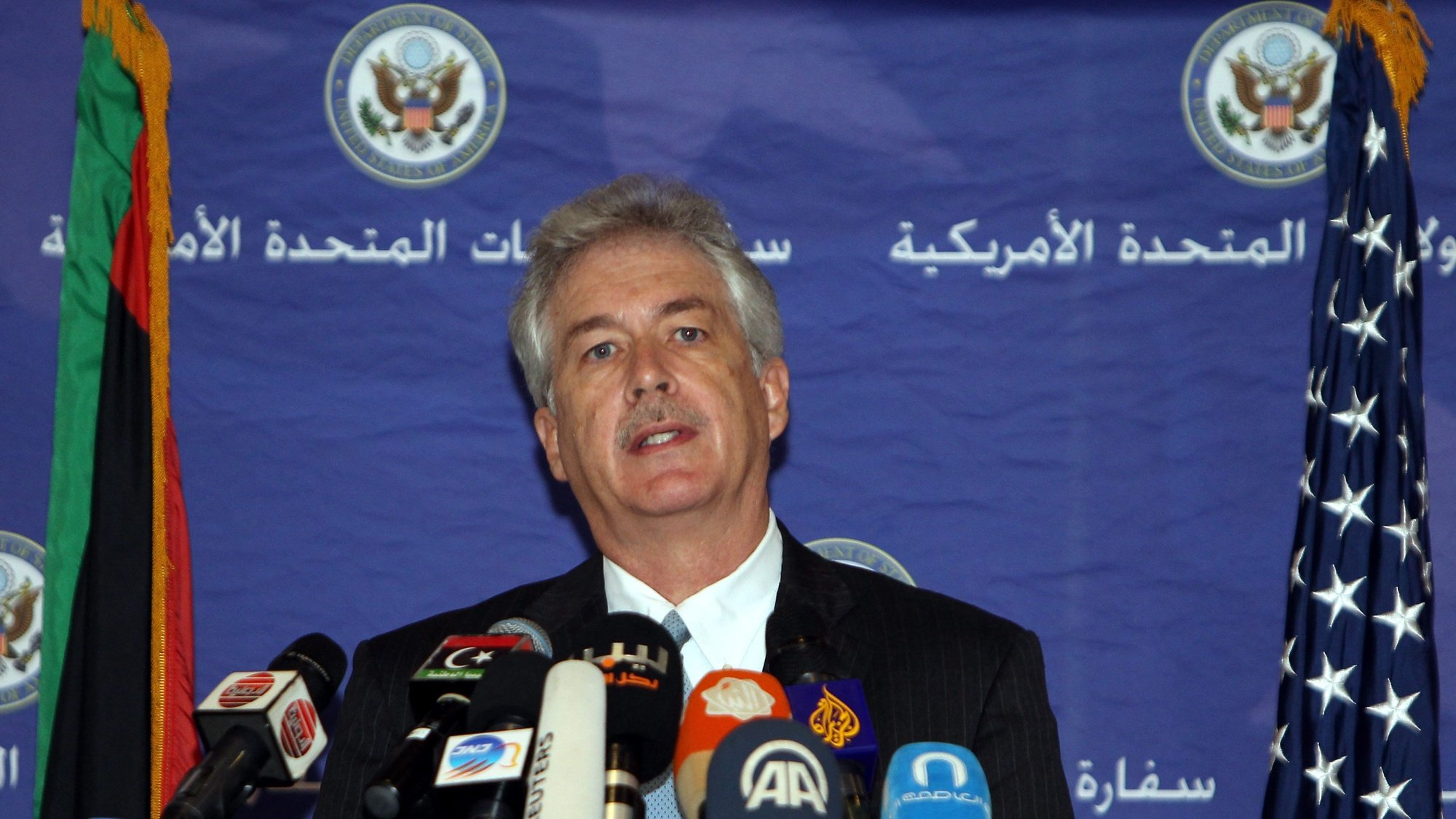 epa04178234 US Deputy Secretary of State William Burns speaks during a press conference in Tripoli, Libya, 24 April 2014. Burns arrived in Libya on 23 April to meet with senior officials. The State Department said the trip reaffirms the US support for the Libyan people as they work to achieve the aspirations of the revolution.  EPA/SABRI ELMHEDWI