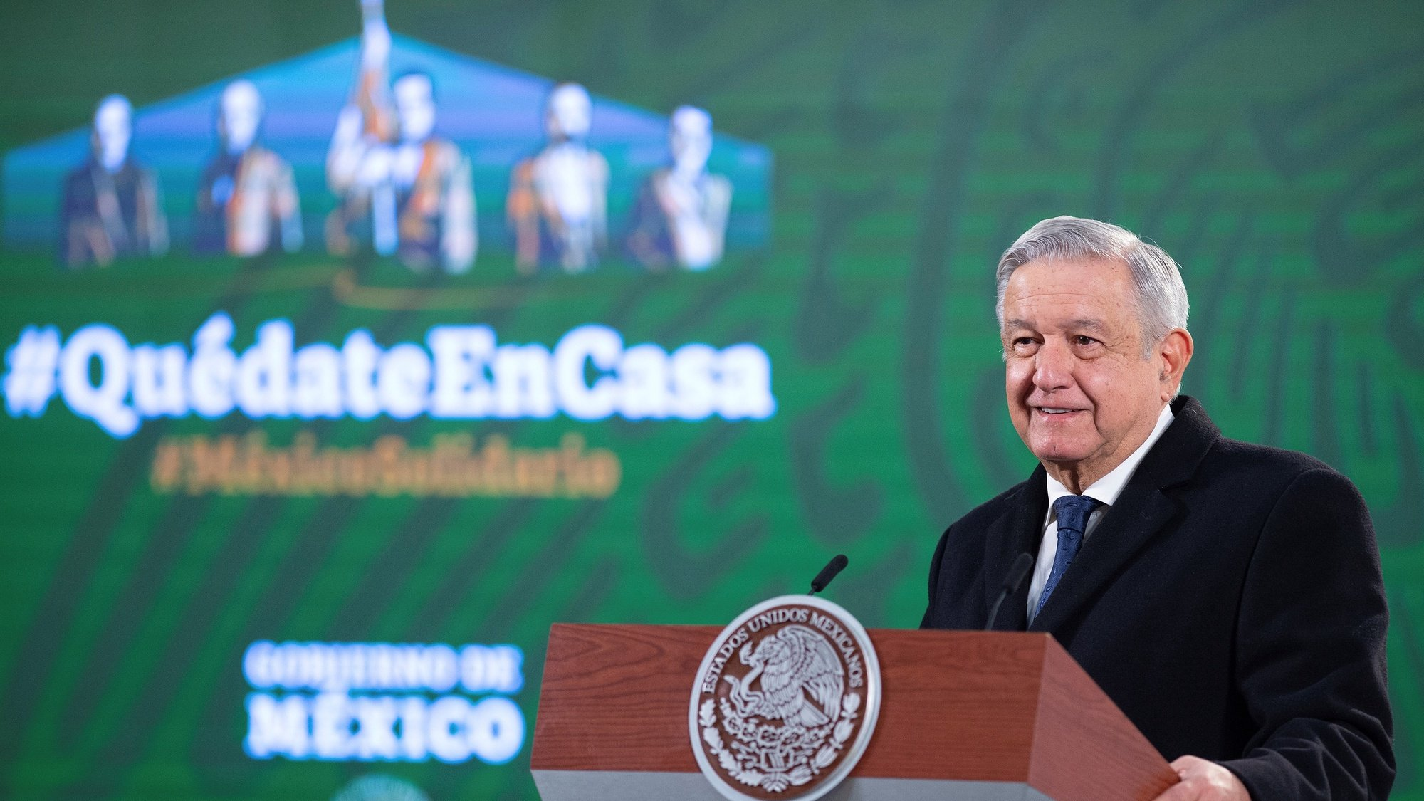 epa08926644 A handout photo made available by Mexico's Presidency shows President Andres Manuel Lopez Obrador during a press conference at the Palacio Nacional in Mexico City, Mexico, 08 January 2021. Lopez Obrador said the Government expects a shipment of the AstraZeneca vaccine, as the Russian vaccine Sputnik V is paying the protocol for the country's acceptance.  EPA/Mexico's Presidency / HANDOUT  HANDOUT EDITORIAL USE ONLY/NO SALES