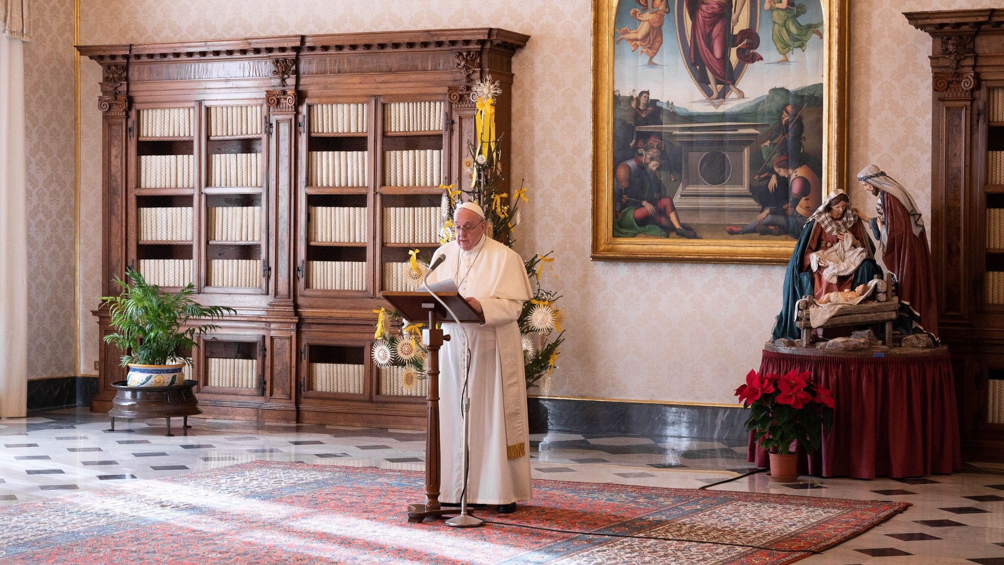epa08907211 A handout picture provided by the Vatican Media shows Pope Francis during his Angelus Prayer from the library of the Palazzo Apostolico, in Vatican City, 27 December 2020 (issued 28 December 2020).  EPA/VATICAN MEDIA HANDOUT  HANDOUT EDITORIAL USE ONLY/NO SALES