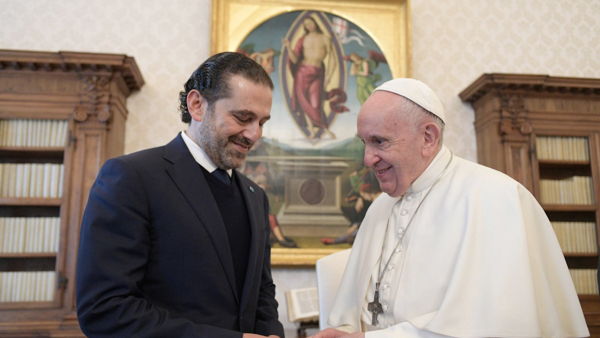 epa09152267 A handout picture provided by the Vatican Media shows Pope Francis receiving the Prime Minister designate of Lebanon, Saad Hariri (L), during a private audience at the Vatican, 22 April 2021.  EPA/VATICAN MEDIA HANDOUT  HANDOUT EDITORIAL USE ONLY/NO SALES