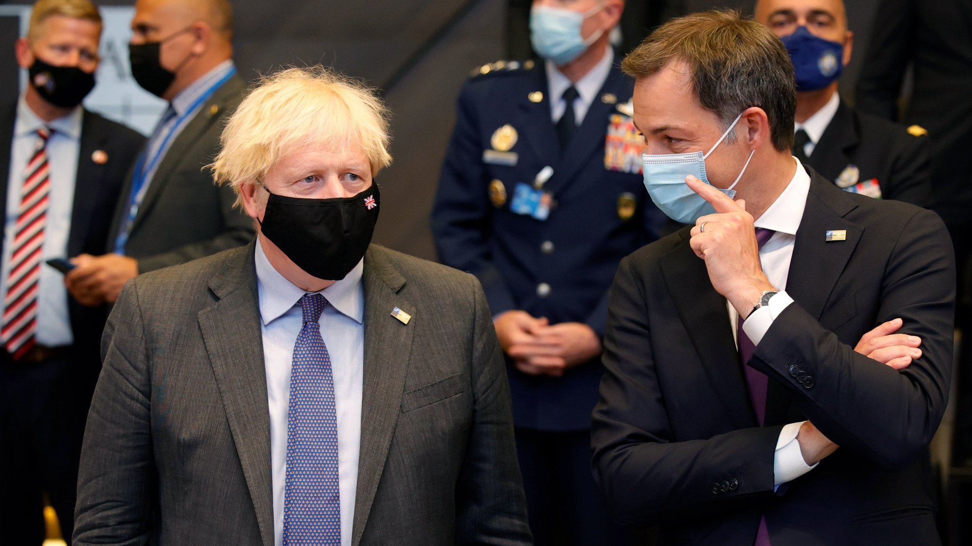 epa09270199 British Prime Minister Boris Johnson (L) speaks with Belgium's Prime Minister Alexander De Croo during a plenary session at a NATO summit in Brussels, Belgium, 14 June 2021. The 30-nation alliance hopes to reaffirm its unity and discuss increasingly tense relations with China and Russia, as the organization pulls its troops out after 18 years in Afghanistan.  EPA/OLIVIER MATTHYS / POOL