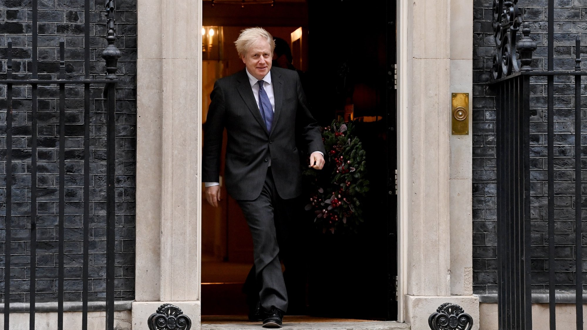 epa08874693 Britain's Prime Minister Boris Johnson welcomes Crown Prince of the Emirate of Abu Dhabi, Sheikh Mohammed bin Zayed Al Nahyan (not pictured) to his official residence at 10 Downing Street in London, Britain, 10 December 2020.  EPA/FACUNDO ARRIZABALAGA