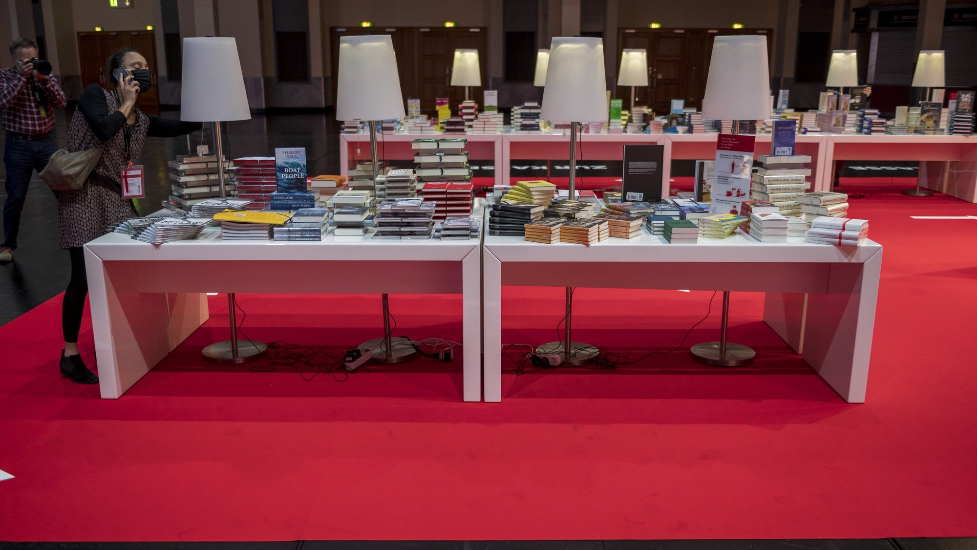 epa08740309 A general view of a table with books prior to the opening conference of the 2020 Frankfurt Book Fair during the coronavirus pandemic in the 'Festhalle' in Frankfurt am Main, 13 October 2020. The Frankfurt Book Fair is the world's largest trade fair for books but is taking place this year at a much smaller scale and with many events either online or scattered throughout the city of Frankfurt due to the coronavirus pandemic. This year's Special Edition of the Book Fair takes place from 14 October to 18 October 2020.  EPA/THOMAS LOHNES / POOL