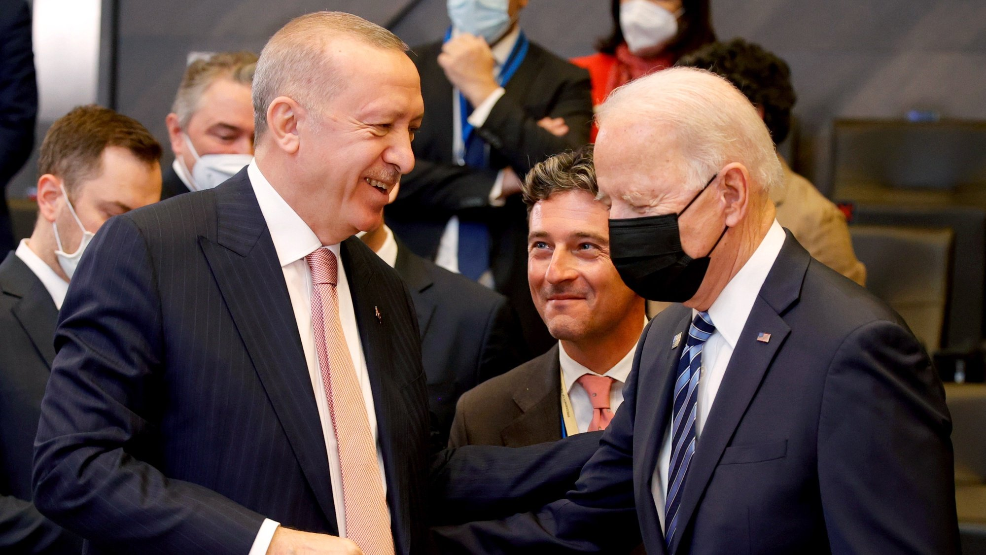 epa09270208 US President Joe Biden (R) speaks with Turkey's President Recep Tayyip Erdogan (L) during a plenary session at a NATO summit in Brussels, Belgium, 14 June 2021. The 30-nation alliance hopes to reaffirm its unity and discuss increasingly tense relations with China and Russia, as the organization pulls its troops out after 18 years in Afghanistan.  EPA/OLIVIER MATTHYS / POOL