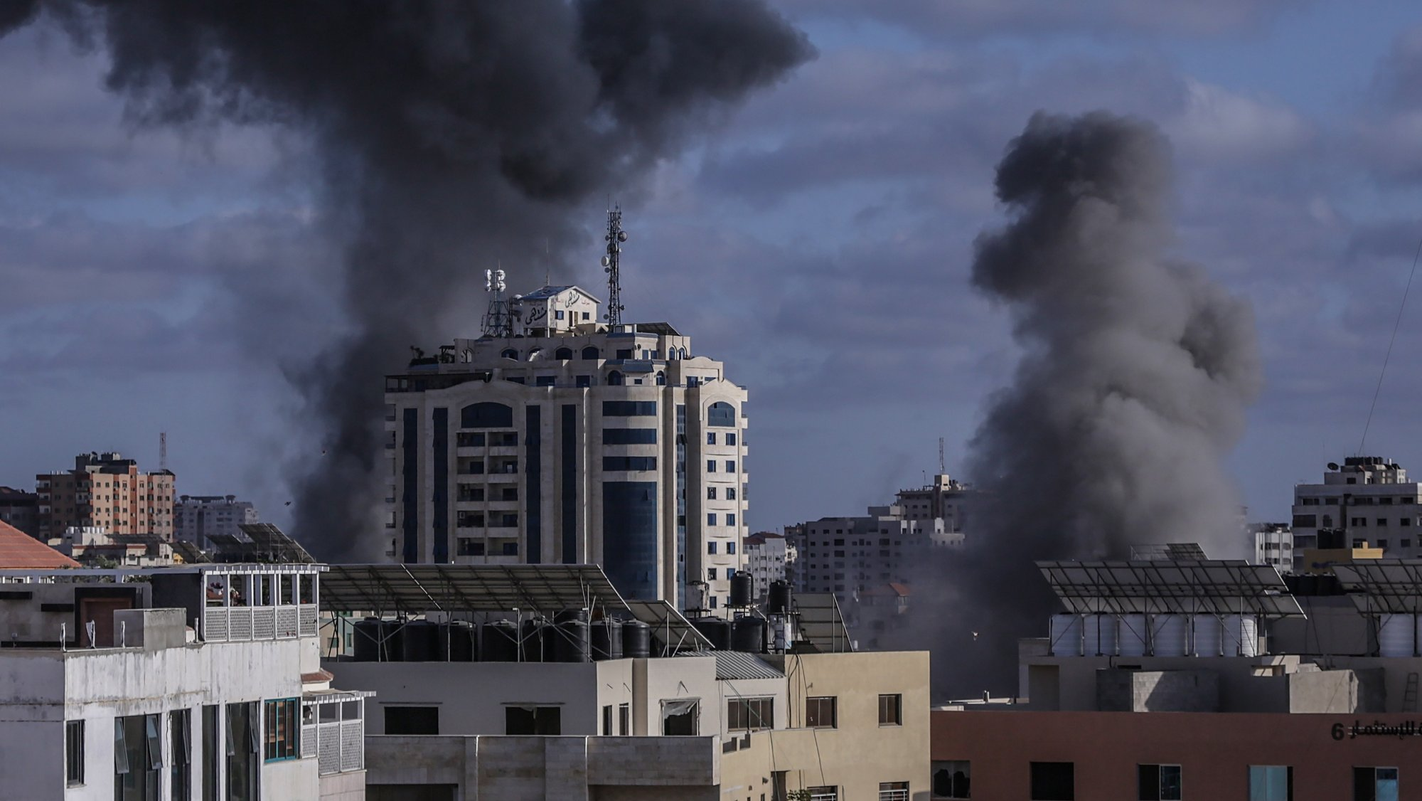 epa09207489 Smoke rise after an israeli air strike in Gaza City, 17 May 2021. In response to days of violent confrontations between Israeli security forces and Palestinians in Jerusalem, various Palestinian militants factions in Gaza launched rocket attacks since 10 May that killed at least six Israelis to date. Gaza Strip's health ministry said that at least 65 Palestinians, including 13 children, were killed in the recent retaliatory Israeli airstrikes. Hamas confirmed the death of Bassem Issa, its Gaza City commander, during an airstrike.  EPA/HAITHAM IMAD