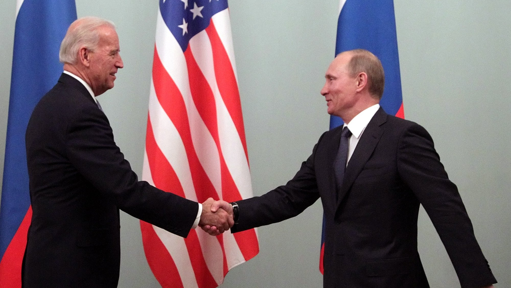 epa08884610 Then US Vice President Joe Biden (L) shakes hands with then Russian Prime Minister Vladimir Putin during their meeting in Moscow, Russia, 10 March 2011 (reissued 15 December 2020). Russian President Vladimir Putin congratulated Joe Biden for his victory in the US presidential election in a telegram published on the Kremlin's website on 15 December 2020.  EPA/MAXIM SHIPENKOV