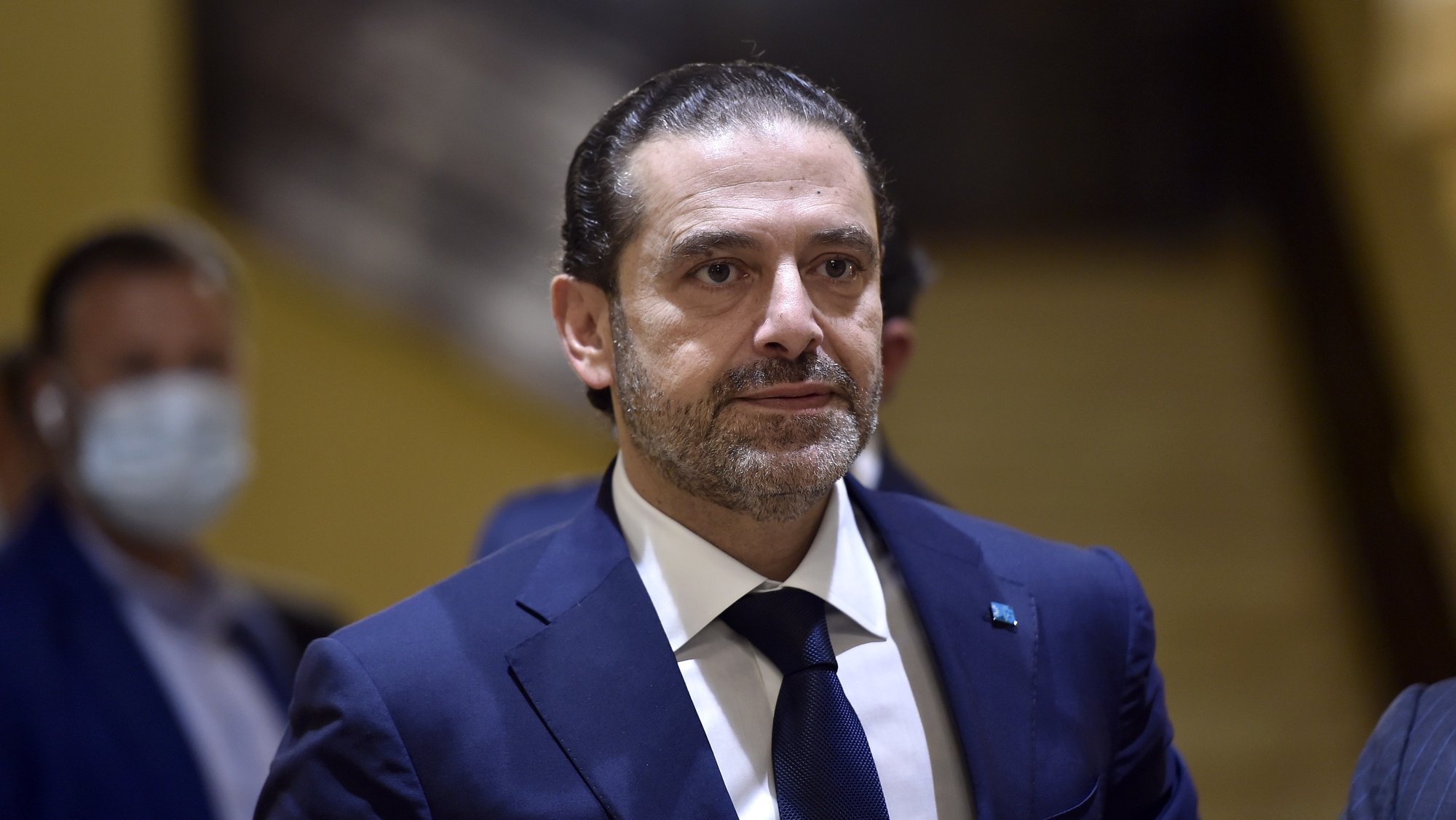 epa09346556 (FILE) - Lebanese Prime Minister-designate Saad Hariri waits before a meeting at his house in Beirut, Lebanon, 07 April 2021 (reissued 15 July 2021). Hariri, who was tasked nine months ago with forming the new government, said on 15 july he is stepping down a day after he presented the cabinet proposal to President Michel Aoun who has not accepted the government.  EPA/WAEL HAMZEH *** Local Caption *** 56811575