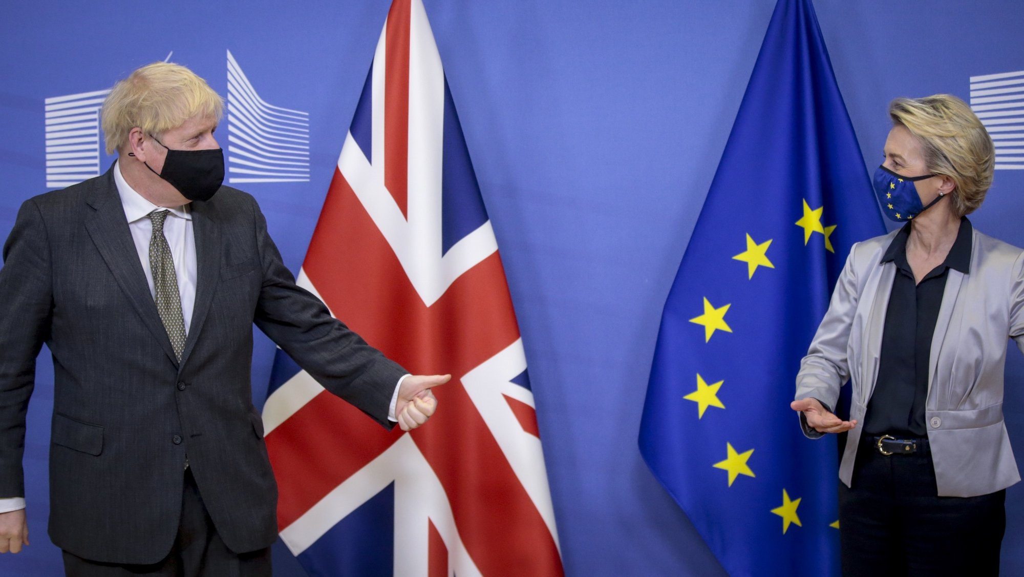 epa08873143 Britain's Prime Minister Boris Johnson (L) gestures towards European Commission President Ursula von der Leyen (R) welcoming him prior to post-Brexit trade deal talks, in Brussels, Belgium, 09 December 2020. A negotiations phase of eleven months that started on 31 January 2020 following the UK's exit from the EU ends on 31 December 2020.  EPA/OLIVIER HOSLET / POOL