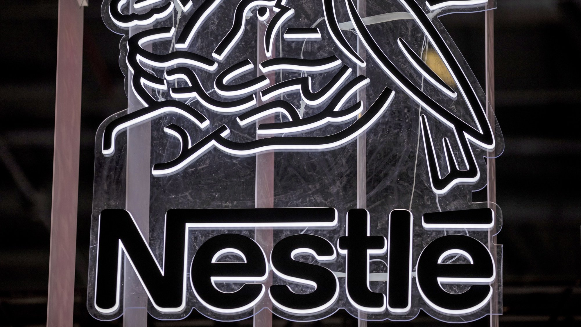 epa09018171 (FILE) - A Nestle logo is seen at the 3rd China International Import Expo in Shanghai, China, 07 November 2020 (reissued 17 February 2021). Nestle is due to release its 2020 full-year results on 18 February 2021.  EPA/ALEX PLAVEVSKI *** Local Caption *** 56531912