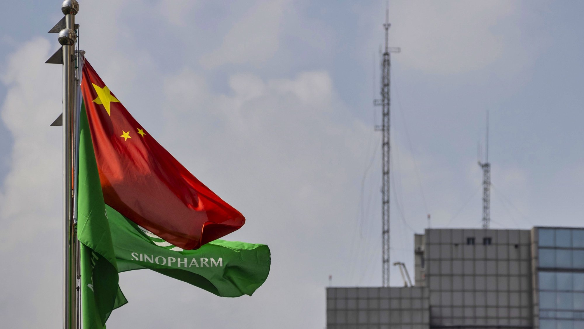 epa08628134 A flag with the Sinopharm company logo flies at the company's headquarters in Shanghai, China, 25 August 2020 (issued 27 August 2020). According to media reports, Sinopharm, major state-owned Chinese pharmaceutical company, plans to have a COVID-19 vaccine on the market by the end of 2020.  EPA/ALEX PLAVEVSKI