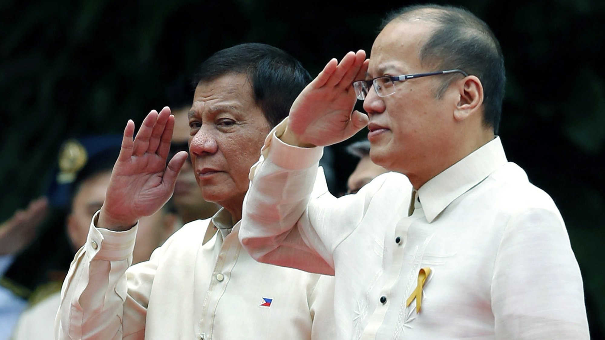 epa09297799 (FILE) - Incoming Filipino President Rodrigo Duterte (L) and outgoing President Benigno Aquino III (R) salute during Duterte's inauguration ceremony at the Malacanang presidential palace grounds in Manila, Philippines, 30 July 2016 (reissued 24 June 2021). Former president of the Philippines Benigno Aquino III died at the age of 61 on 24 June 2021.  EPA/FRANCIS R. MALASIG
