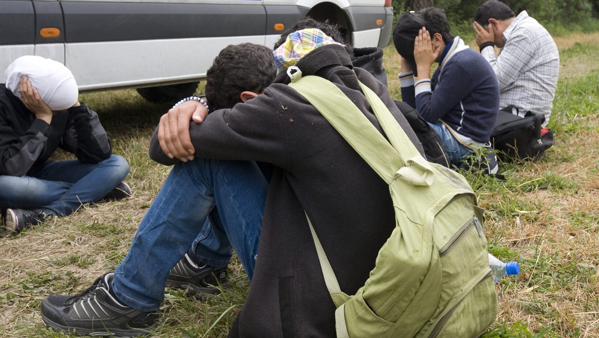epa04814995 Migrants, who were captured on an eyot of the Tisza River, next to a police van near Szeged, 170 kms southeast of Budapest, Hungary, 23 June 2015. EU foreign ministers on 22 June launched a military mission in the Mediterranean Sea aimed at cracking down on migrant smuggling networks and dismantling the trade, as part of a broader effort to curb the loss of life. Half of the EU's 28 member states are taking part in the operation, including Belgium, Britain, Finland, France, Germany, Greece, Hungary, Italy, Lithuania, Luxembourg, the Netherlands, Slovenia, Spain and Sweden.  EPA/ZOLTAN GERGELY KELEMEN HUNGARY OUT