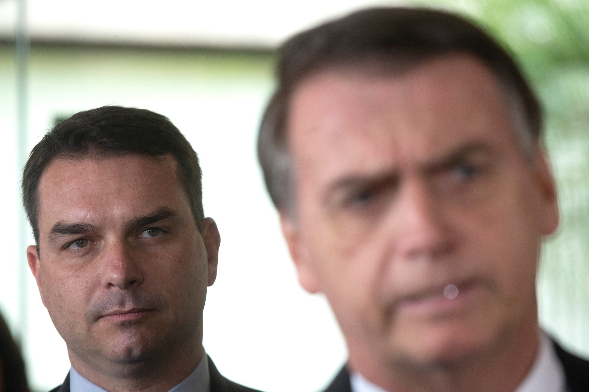 epa08628612 (FILE) - Then Brazilian President-elect Jair Bolsonaro (R) and his son, then elected senator Flavio Bolsonaro (L), arrive at the Supreme Court of Justice for a press conference in Brasilia, Brazil, 07 November 2018 (reissued 27 August 2020). According to the senator's office statement, the eldest son of Brazilian President Jair Bolsonaro, Senator Flavio Bolsonaro, said he has tested positive for the new coronavirus.  EPA/Joedson Alves *** Local Caption *** 54757503