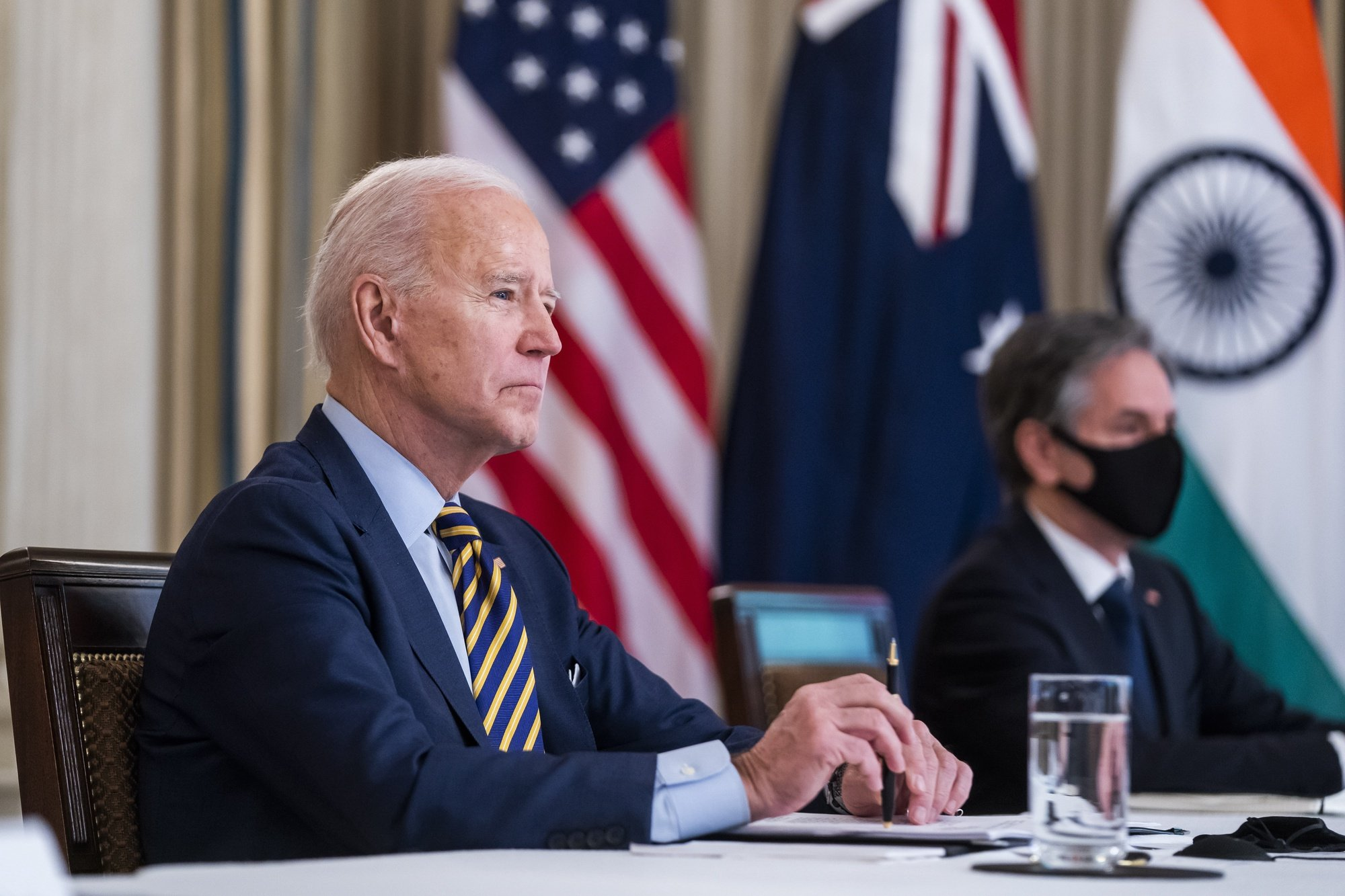 epa09069776 US President Joe Biden (L) and Secretary of State Antony Blinken (R) meet virtually with their counterparts in the 'Quad' Quadrilateral Security Dialogue: Prime Minister Narendra Modi of India, Prime Minister Scott Morrison of Australia and Prime Minister Yoshihide Suga of Japan, from the State Dining Room of the White House in Washington DC, USA, 12 March 2021.  EPA/JIM LO SCALZO