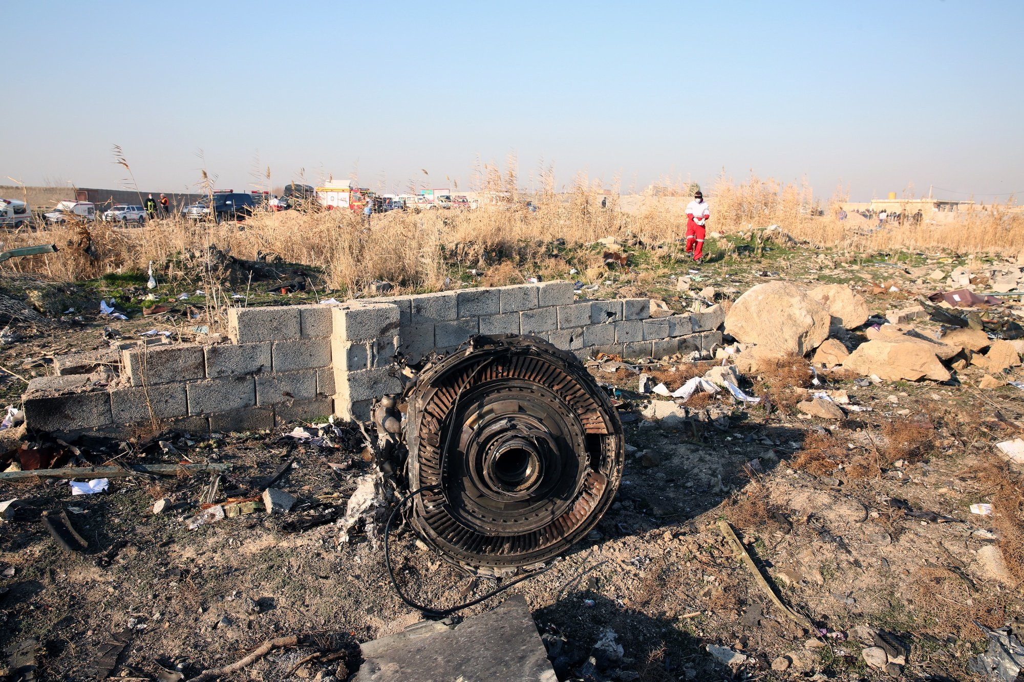 epa08922657 (FILE) - One of the engine of the plane lies among the wreckage after an Ukraine International Airlines Boeing 737-800 carrying 176 people crashed near Imam Khomeini Airport in Tehran, killing everyone on board, in Shahriar, Iran, 08 January 2020 (reissued 06 January 2021). A Ukrainian International Airlines passenger plane was downed by Iranian armed forces on 08 January 2020 near Tehran, killing all 176 people aboard, after allegedly mistaking it for an incoming missile.  EPA/ABEDIN TAHERKENAREH *** Local Caption *** 55751015