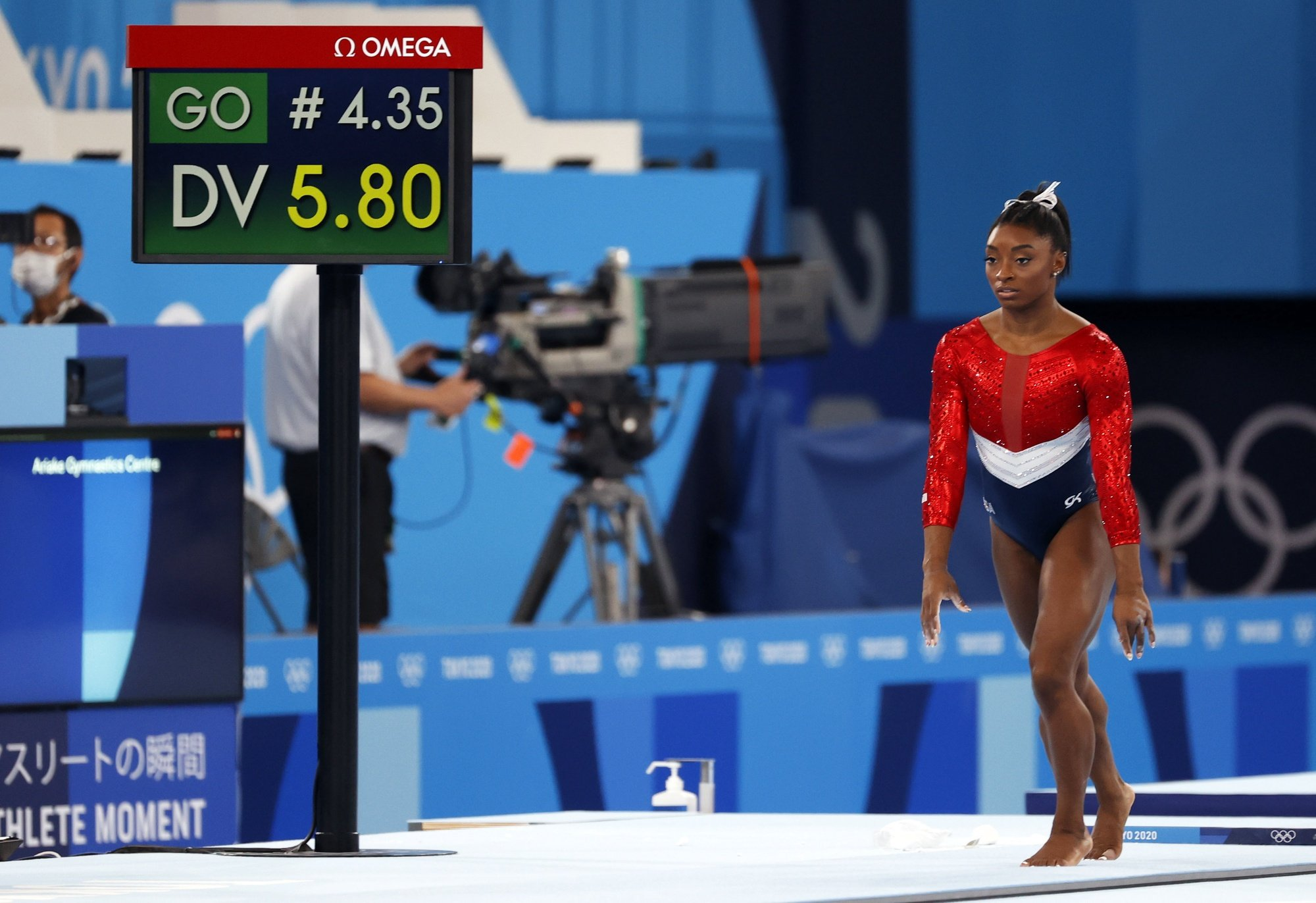 epa09370179 Simone Biles of the USA performs on the Vault during the Women's Team final during the Artistic Gymnastics events of the Tokyo 2020 Olympic Games at the Ariake Gymnastics Centre in Tokyo, Japan, 27 July 2021.  EPA/HOW HWEE YOUNG