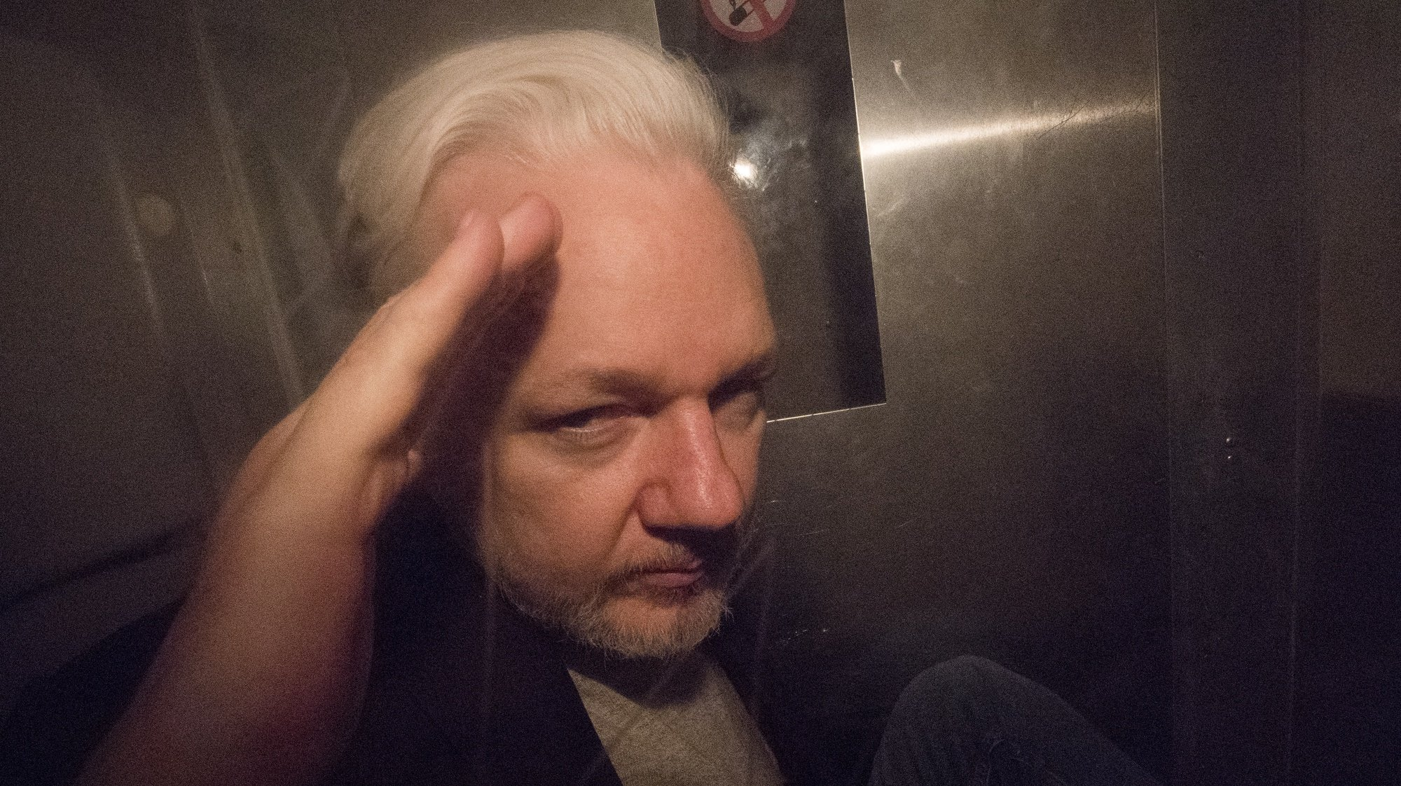 epa07540075 Wikileaks co-founder Julian Assange, in a prison van, as he leaves Southwark Crown Court in London, Britain, 01 May 2019. The Wikileaks co-founder Julian Assange has been sentenced to 50 week in prison for breaching his bail conditions. Assange was found guilty of breaching the Bail Act in April after his arrest after spending seven year in the Ecuadorian Embassy in London.  EPA/NEIL HALL