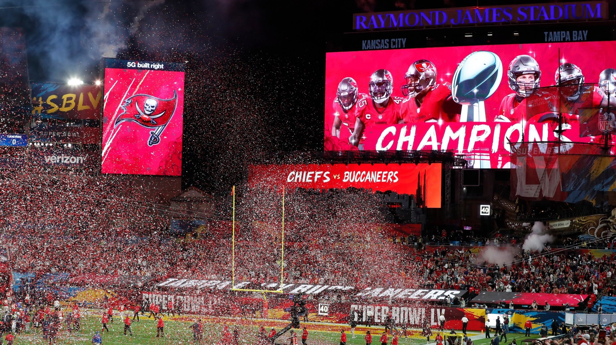epa08995303 Tampa Bay Buccaneers on the big screen after the Tampa Bay Buccaneers defeating the Kansas City Chiefs in the National Football League Super Bowl LV at Raymond James Stadium in Tampa, Florida, USA, 07 February 2021.  EPA/GARY BOGDON