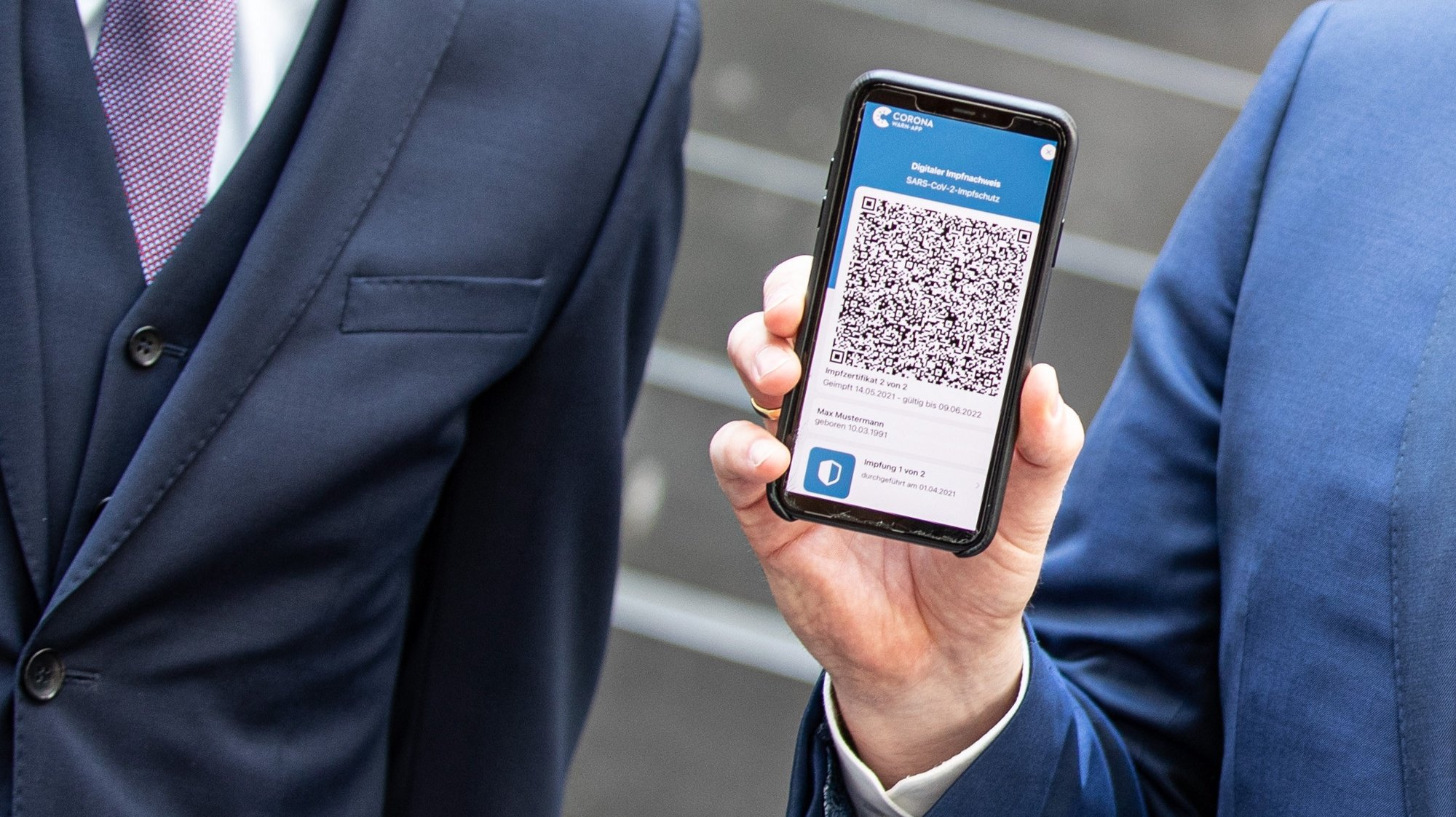 epa09259316 Smartphone with CivPass App and QR-Code at Federal Press Conference on current  pandemic situation, in Berlin, Germany, 10 June 2021. Germany released CovPass App for smartphones that provides users with digital certificate of vaccination against covid-19 as well as details of test results and survived infections using QR code.  EPA/ANDREAS GORA / POOL