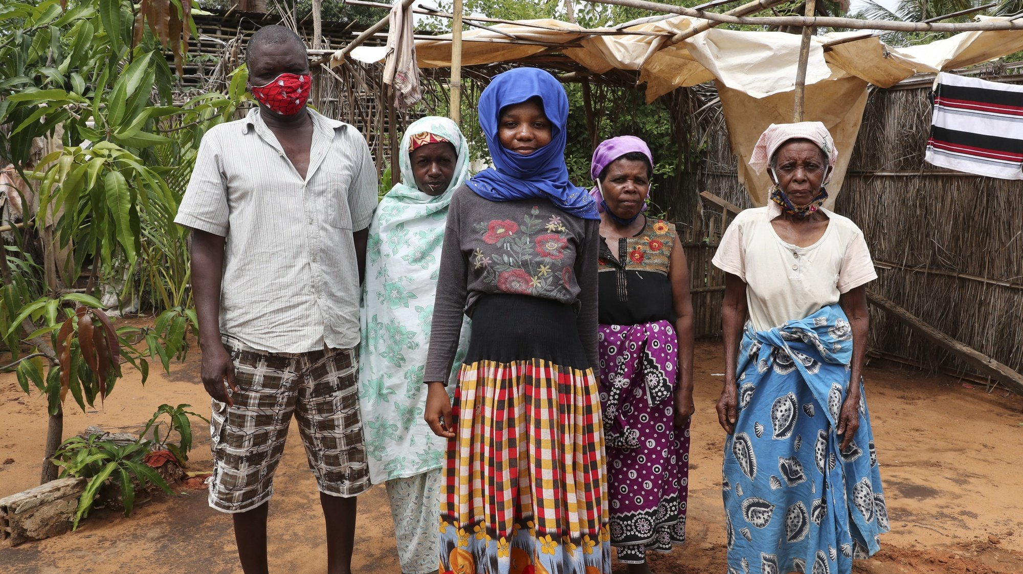 epa09133250 Ubaia Ureli (L) and his wife Mungui Anli (2-L) lost contact with the rest of their family during the conflicts and live in a house with 3 other family members, all displaced from Palma, borrowed from a family friend, Pemba, Mozambique, 13 April 2021. Armed violence in Cabo Delgado began more than three years ago, but escalated again two weeks ago when armed groups first attacked the village of Palma, which is about six kilometers from the multimillion-dollar natural gas projects.  EPA/JOAO RELVAS