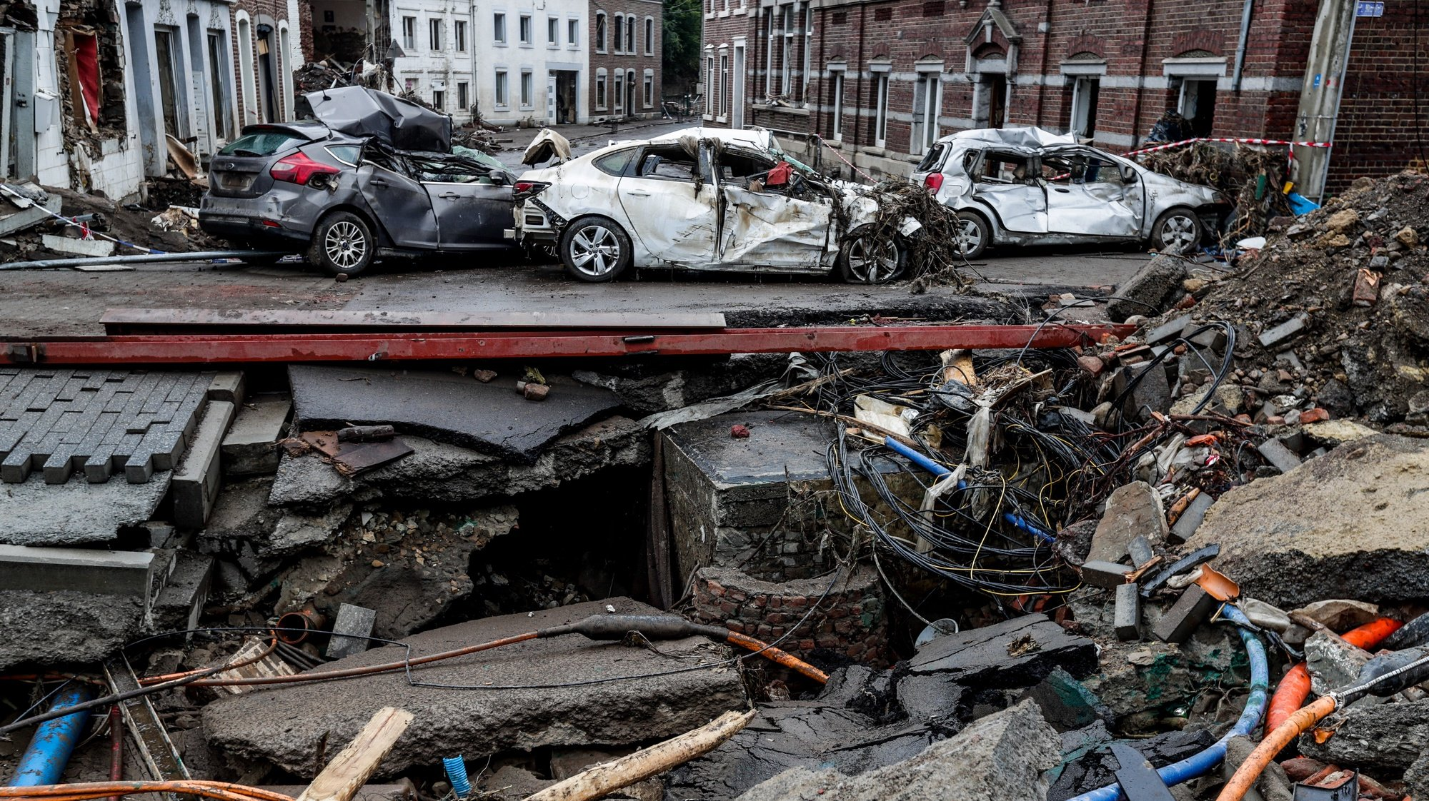 epaselect epa09362387 A view of damaged cars in Pepinster, Belgium, 24 July 2021. Heavy rains caused widespread damage and flooding in parts of Belgium and across central Europe in the night of 14/15 July. Dozens have died and many remain unaccounted for.  EPA/STEPHANIE LECOCQ