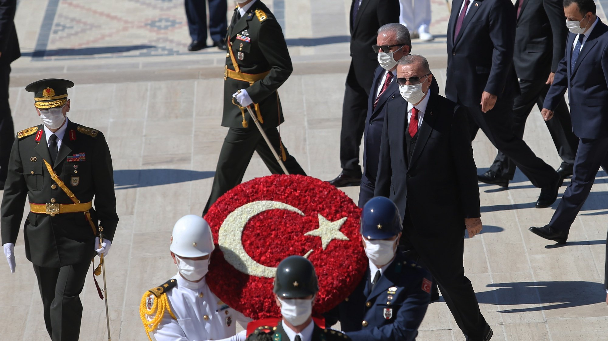 epa08635648 Turkish President Recep Tayyip Erdogan (C) and Turkish Grand National Assembly (TBMM) Speaker Mustafa Sentop (C-L) attend wreath laying ceremony at the Mausoleum of Mustafa Kemal Ataturk, founder of the modern Turkey, during a parade to mark Victory Day in Ankara, Turkey, 30 August 2020. Turkey celebrates its Victory Day in commemoration of the Battle of Dumlupinar, a key victory over Greece on 30 August 1922 in Turkey's War of Independence.  EPA/STR