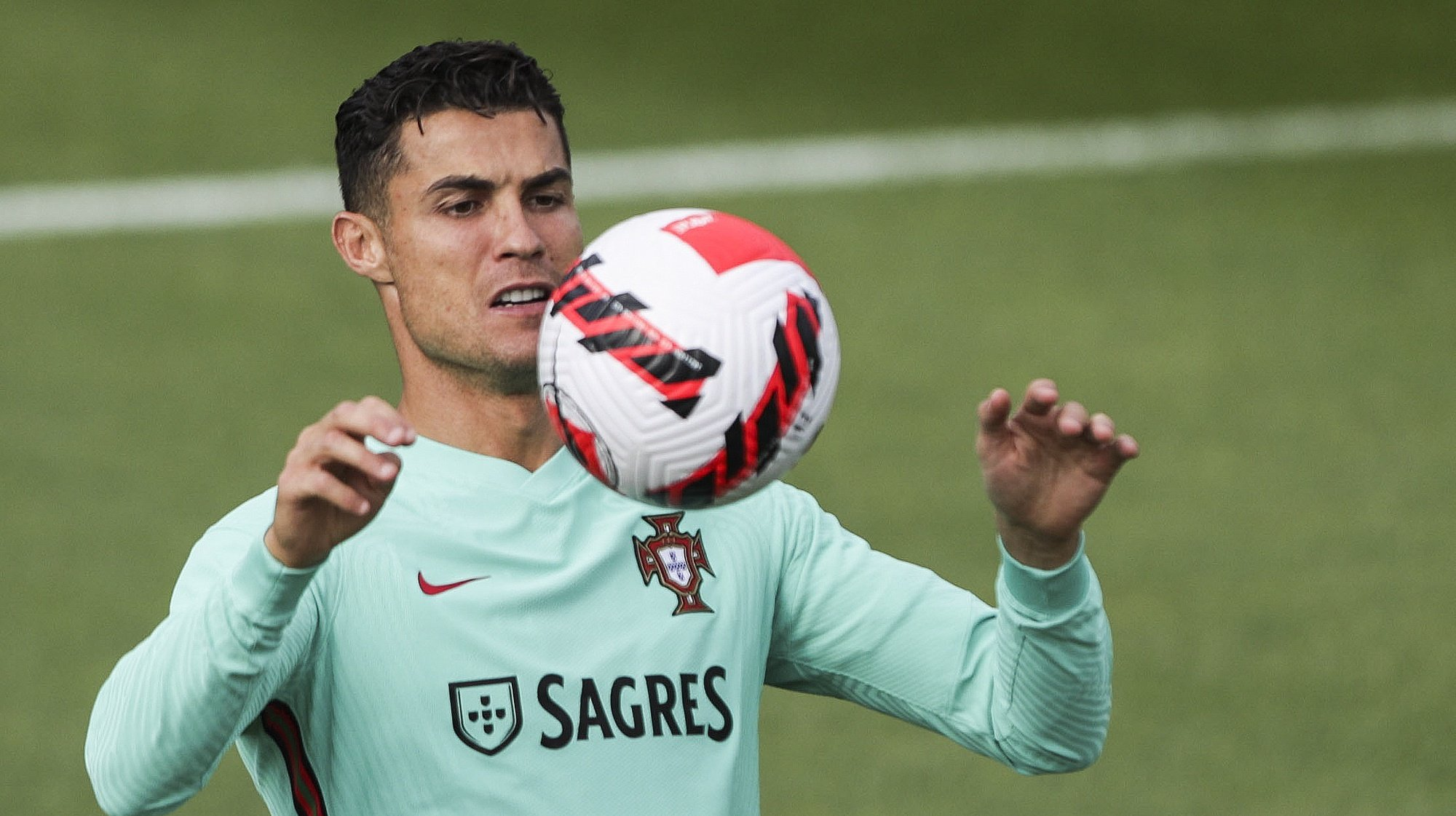 epa09507688 Portuguese soccer player Cristiano Ronaldo in action during Portugal´s national team training session at Oeiras, outskirts of Lisbon, Portugal, 05 October 2021.  EPA/TIAGO PETINGA