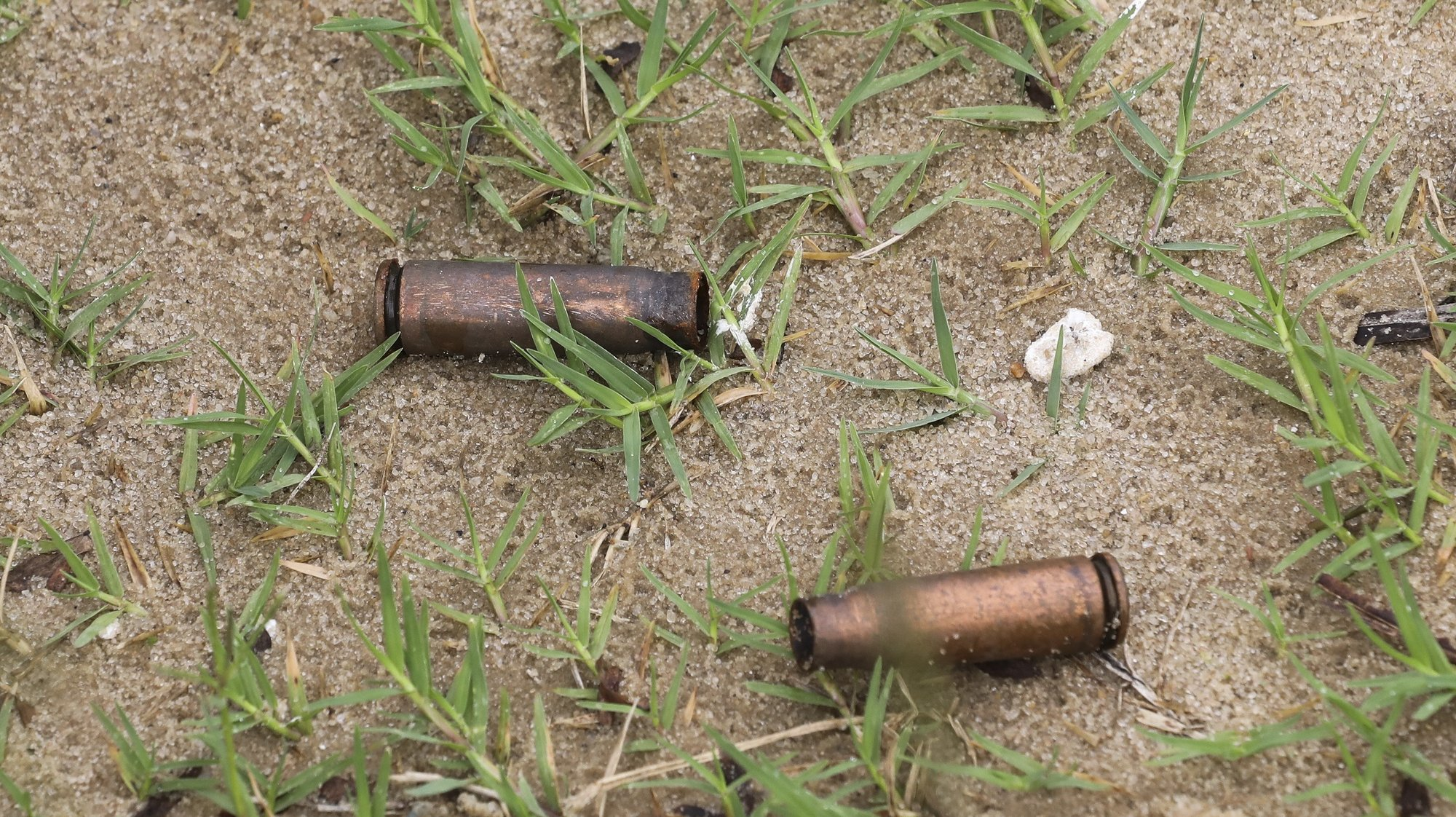 epa09131133 Spent AK rifle capsules in the street of Palma, Cabo Delgado, Mozambique, 12 April 2021. The violence unleashed more than three years ago in Cabo Delgado province escalated again about two weeks ago, when armed groups first attacked the town of Palma.  EPA/JOAO RELVAS