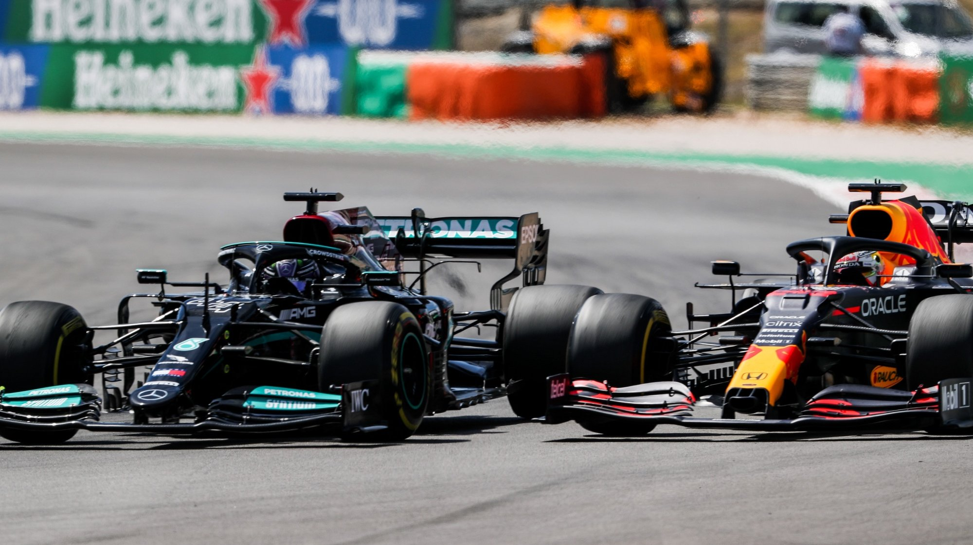 epa09174306 British Formula One driver Lewis Hamilton (L) of Mercedes-AMG Petronas is on his way to win the 2021 Formula One Grand Prix of Portugal at the Autodromo Internacional do Algarve near Portimao, Portugal, 02 May 2021. Hamilton won ahead of second placed Dutch driver Max Verstappen (R) of Red Bull Racing.  EPA/JOSE SENA GOULAO