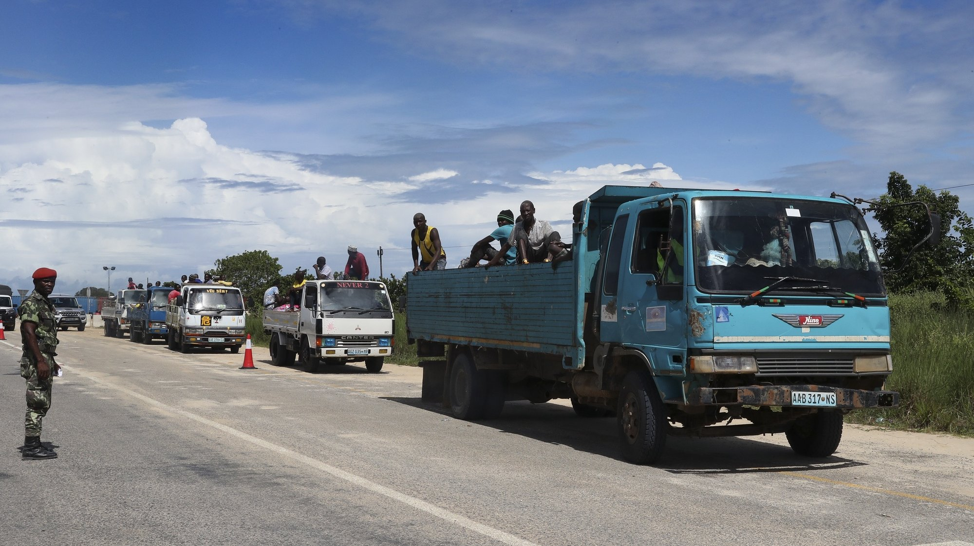 epa09125117 Truck convoy with suplies to Palma, Cabo Delgado, Mozambique, 09 April 2021. The violence unleashed more than three years ago in Cabo Delgado province escalated again about two weeks ago, when armed groups first attacked the town of Palma.  EPA/JOAO RELVAS