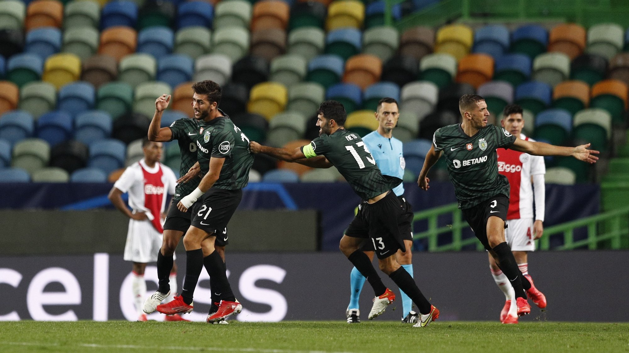 Sporting player Paulinho (L) celebrates after scoring a goal against Ajax during their UEFA Champions League Group C soccer match at Jose Alvalade Stadium in Lisbon, Portugal, 15 September 2021. ANTONIO COTRIM/LUSA