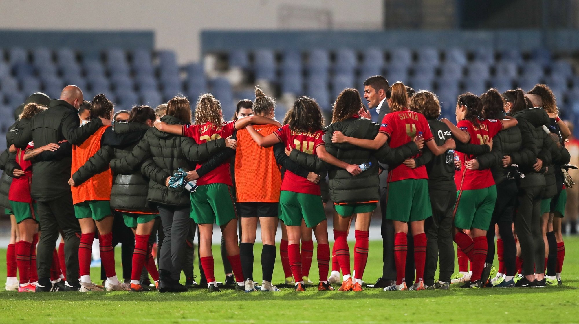 epa09125385 Portugal's head coach Francisco Neto talks the his players after the UEFA Women's EURO play-off match at Restelo Stadium in Lisbon, Portugal, 09 April 2021.  EPA/MIGUEL A. LOPES