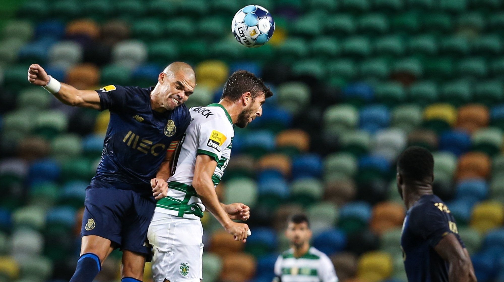 Sporting's Paulinho (R) in action against FC Porto's Pepe (L) during the Portuguese First League soccer match between Sporting and FC Porto at José de Alvalade Stadium in Lisbon, Portugal, 11 September 2021. RODRIGO ANTUNES/LUSA
