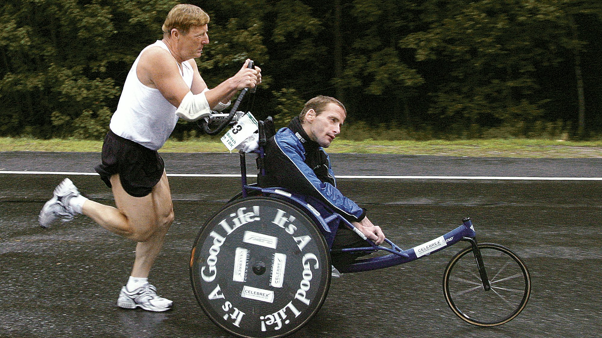 Dick Hoyt pushes his son Rick off from the starting line at the Peoples Beach to Beacon 10K road rac