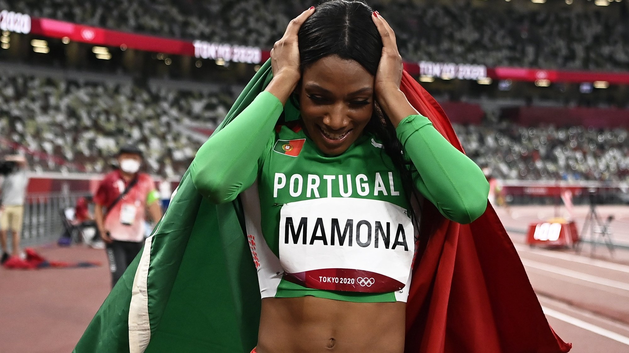 epa09385771 Silver medalist Patricia Mamona of Portugal celebrates after the Women's triple jump final during the Athletics events of the Tokyo 2020 Olympic Games at the Olympic Stadium in Tokyo, Japan, 01 August 2021.  EPA/CHRISTIAN BRUNA