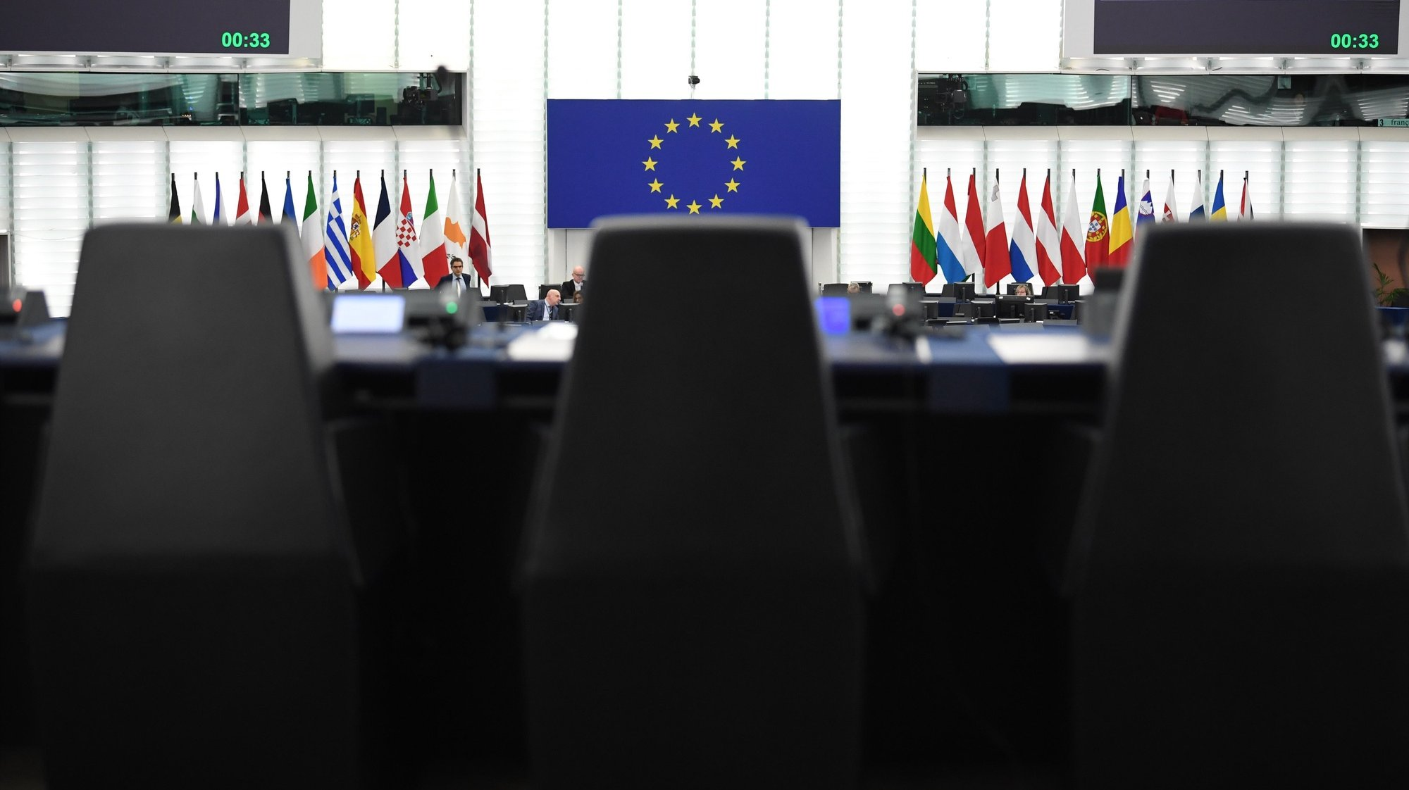 epa08127800 Empty chairs are in front of the European flag before the debate on the consequences of the latest confrontation between the US and Iran at the European Parliament in Strasbourg, France, 14 January 2020.  EPA/PATRICK SEEGER